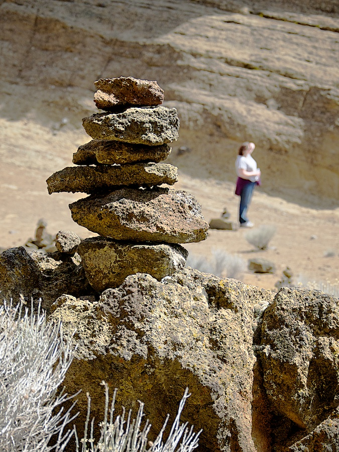 A bit on the whimsical side, at the center of Fort Rock, there are dozens of rock stacks. The abundance of loose rocks invite you to build yet another stack, or improve on an existing one.