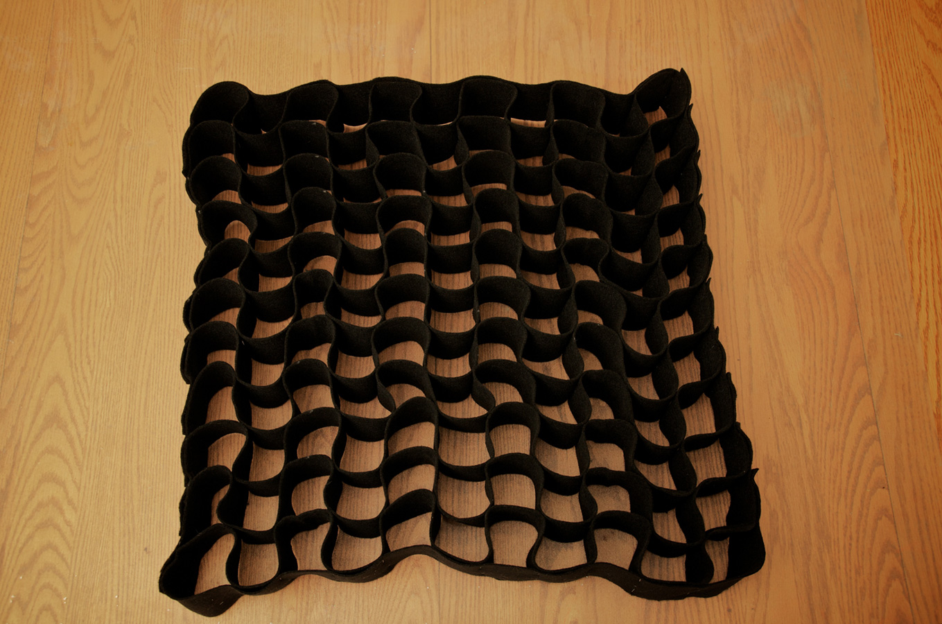 Completed DIY softbox grid made from cloth strips.