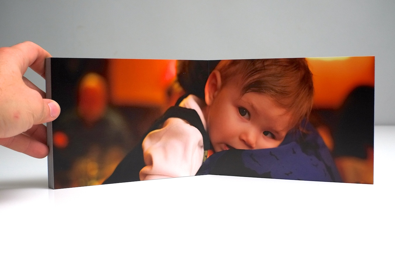 The Little Black Book's unique lay-flat binding allows photos to spread across the entire page beautifully