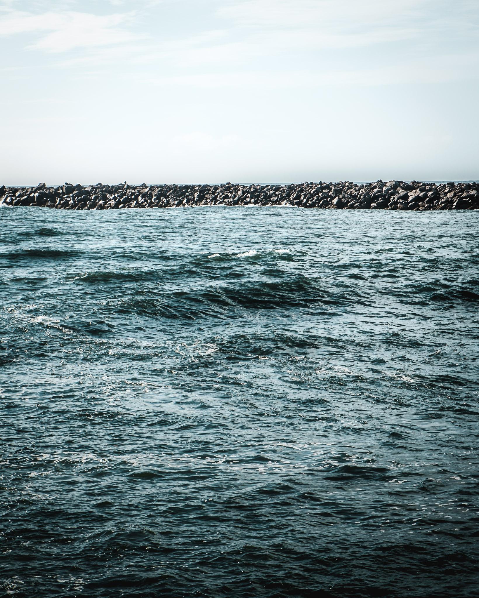 Four foot seas. Jetty at Newport, Oregon. Fujifilm XE-1, XF18-55mm @ 53mm, ISO 200, f/11, 1/250.