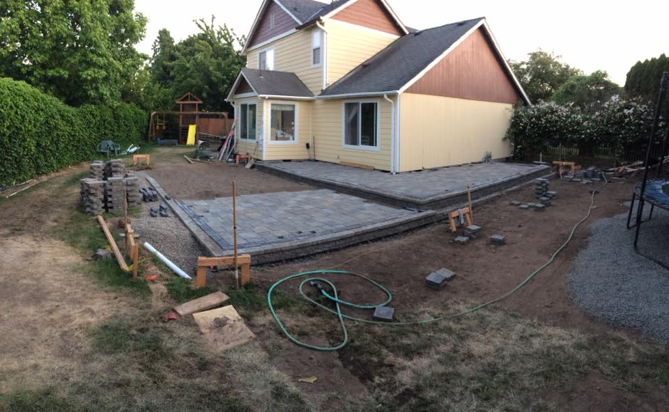 Laying the patio pavers - after many days of grading, moving, and compacting gravel.  [ iPhone SE ]