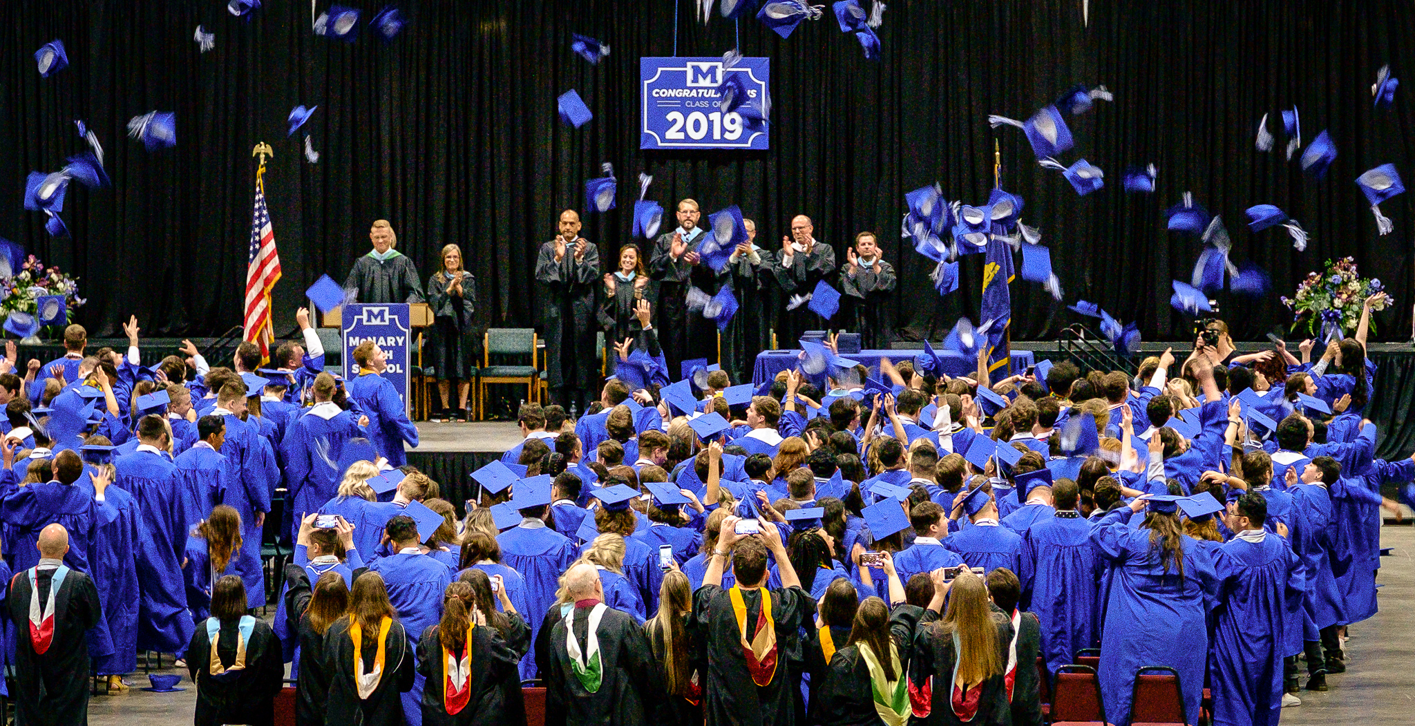 McNary class of 2019 cap toss, Abigail's graduation  [ Fujifilm X-E1, XF50-140mm @106mm, f/4.0, 1/60s, ISO 3200 ]