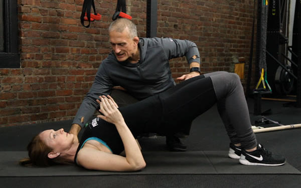 Steve Maxwell demonstrating a hip bridge isometric holding exercise in his latest video download.
