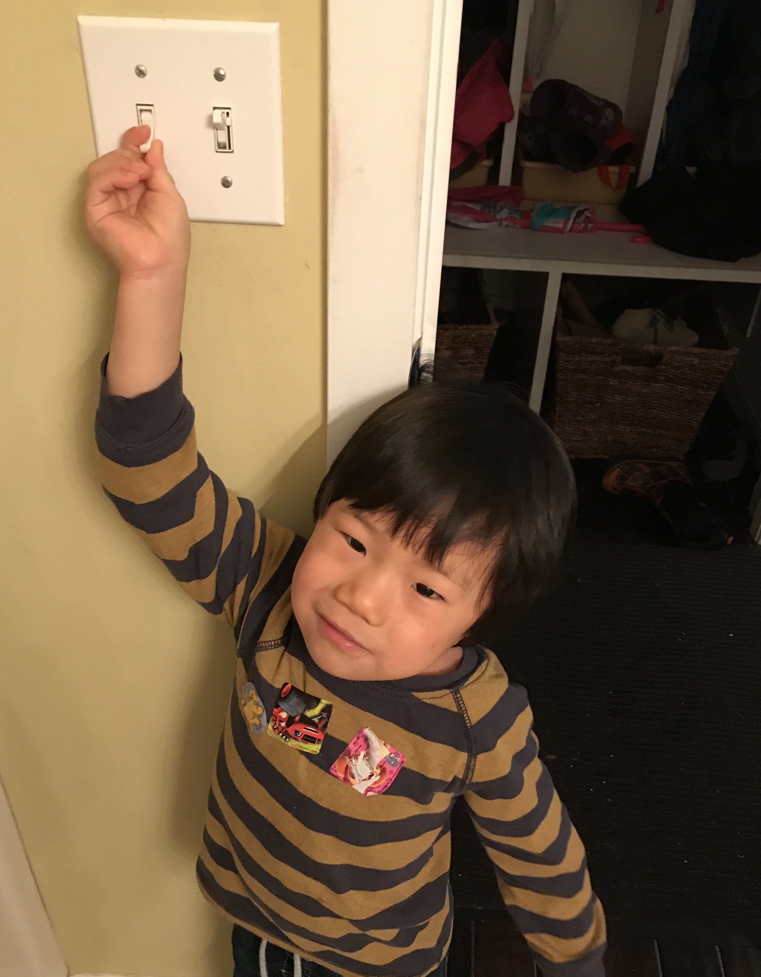 Joshua discovering that this switch actually did something. He had never heard the ceiling fan before and rejoiced in hearing it time and time and time again today!