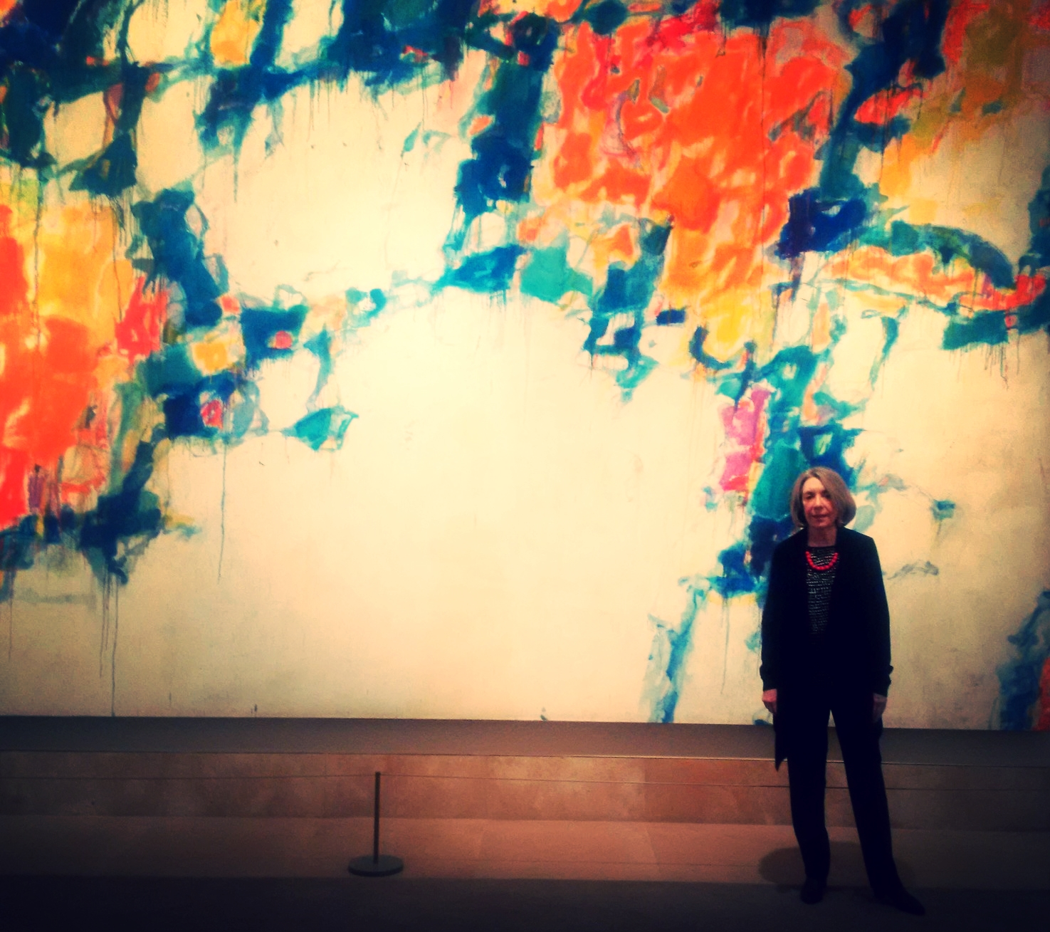Marilyn Pearl Loesberg, a collector and member of Board of the Palm Springs Museum, in front of a painting bySam Francis at the  Norton Simon Museum, LA