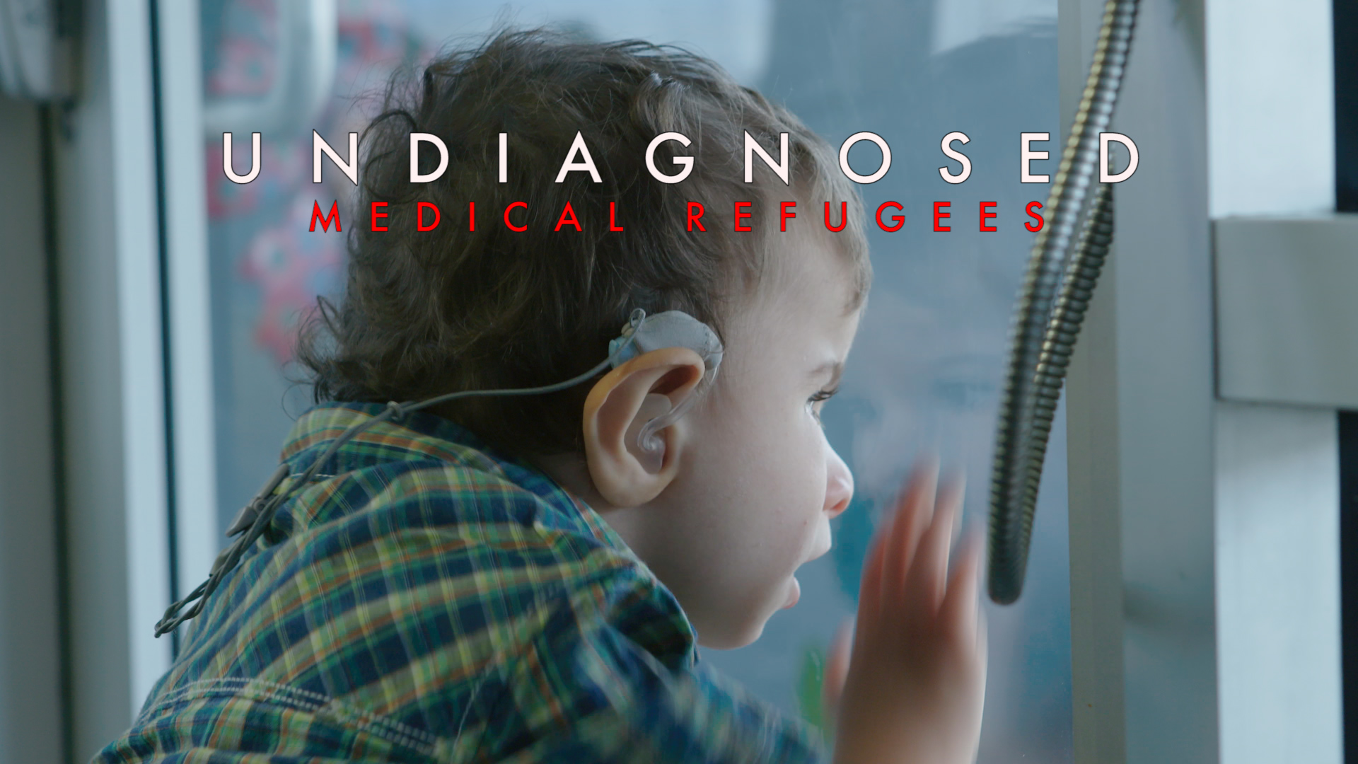 Braxton peers out a window while mom talks about their undiagnosed journey. This haunting image became the movie trailer front image.