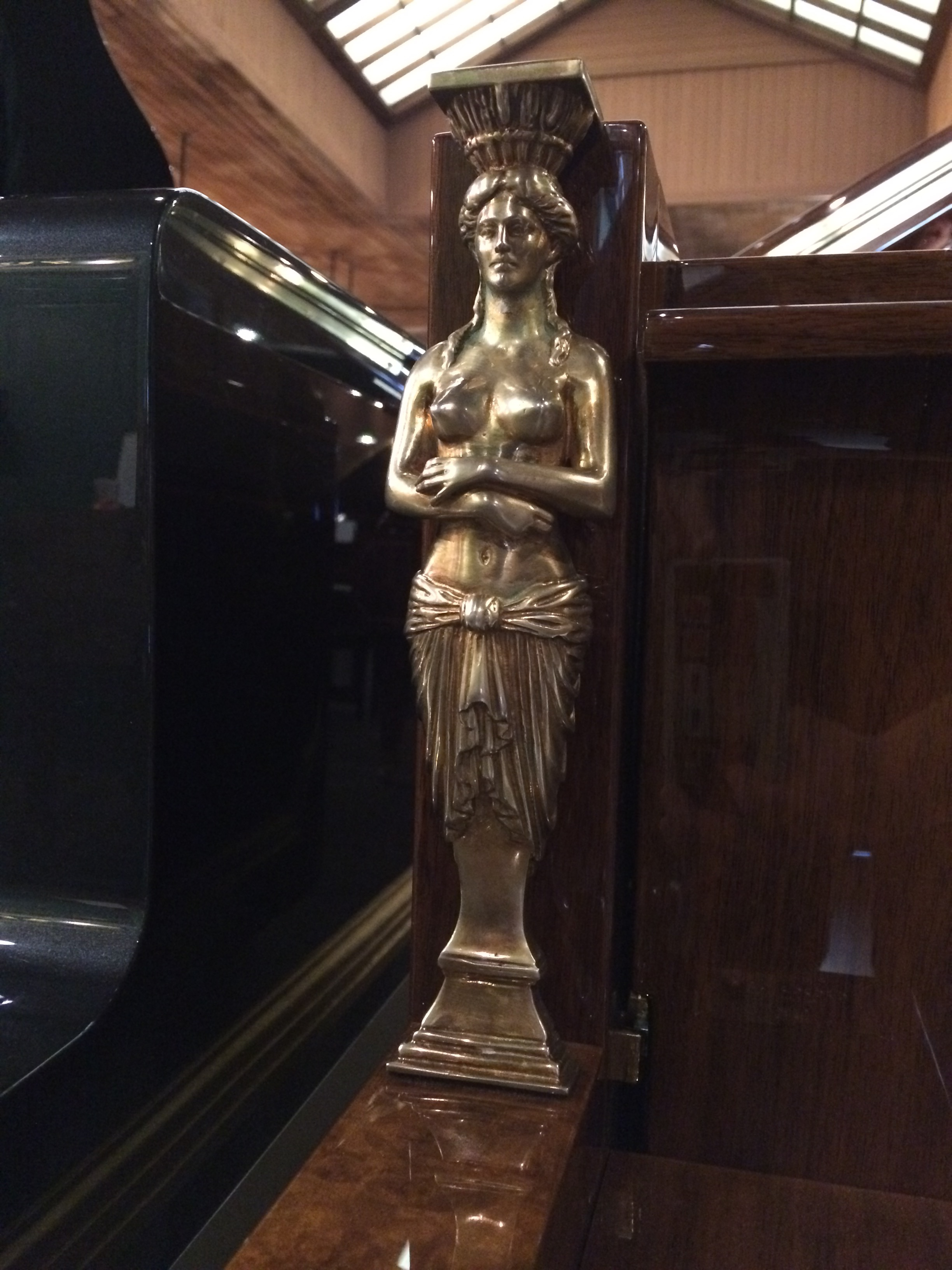 This statue and the one that bookends the keys is made of 24 carat gold.