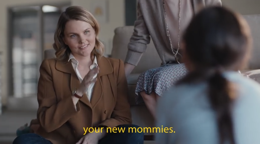 """We are going to be your new mommies"". Screencap via YouTube."