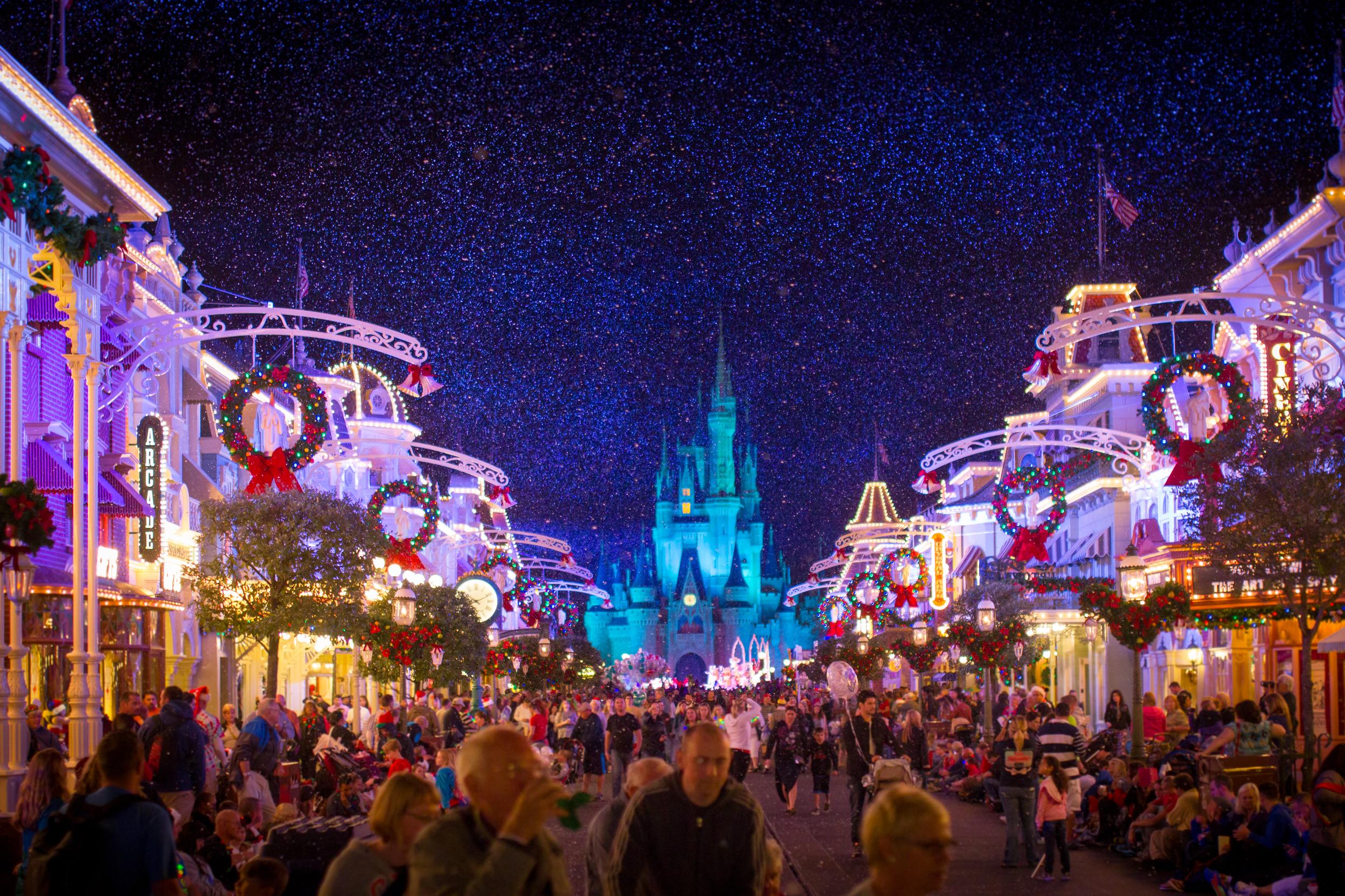Cinderella's Castle in the background of a snowy Main Street, USA at the Magic Kingdom inside Walt Disney World.