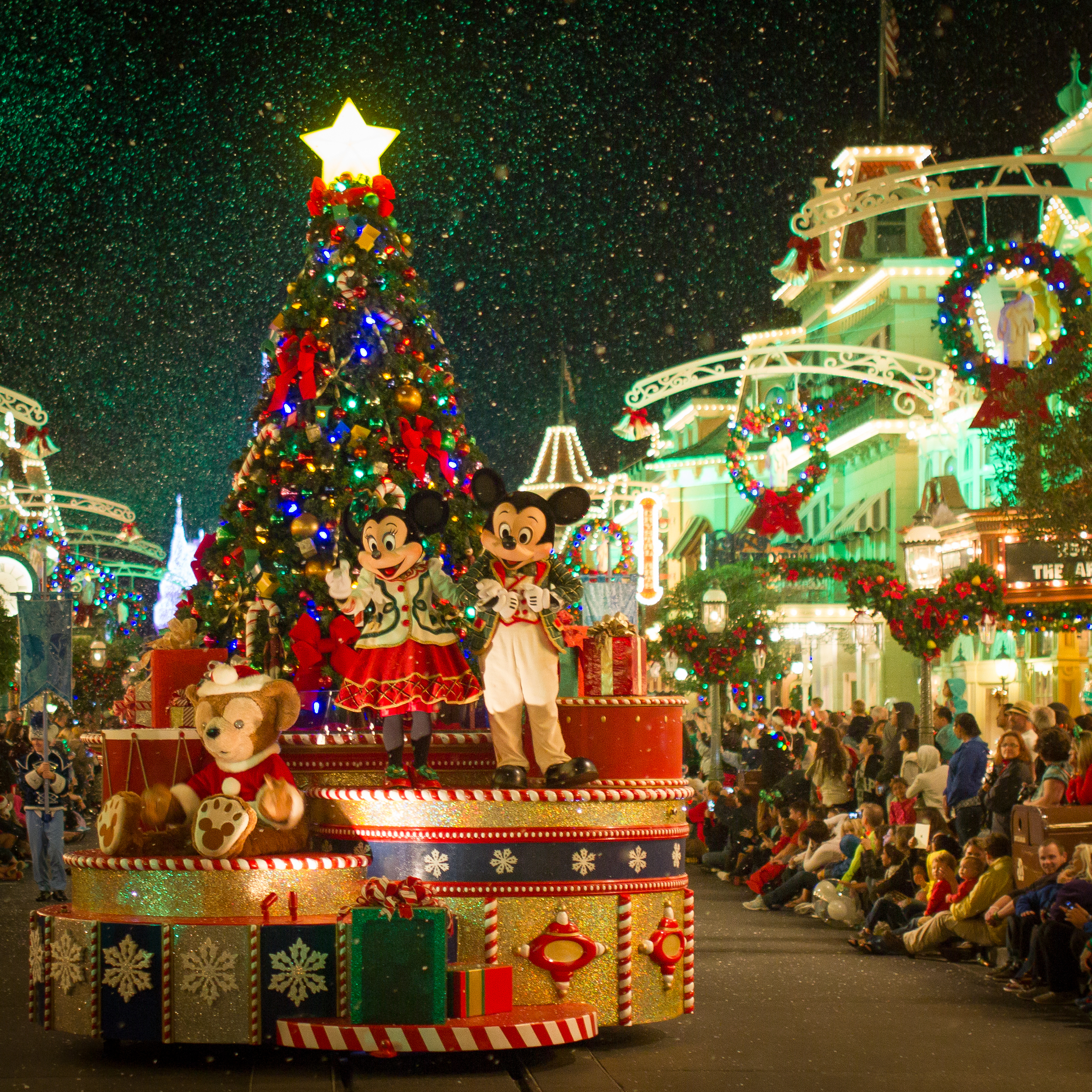 Mickey and Minnie float down Main Street during Mickey's Very Merry Christmas Party.