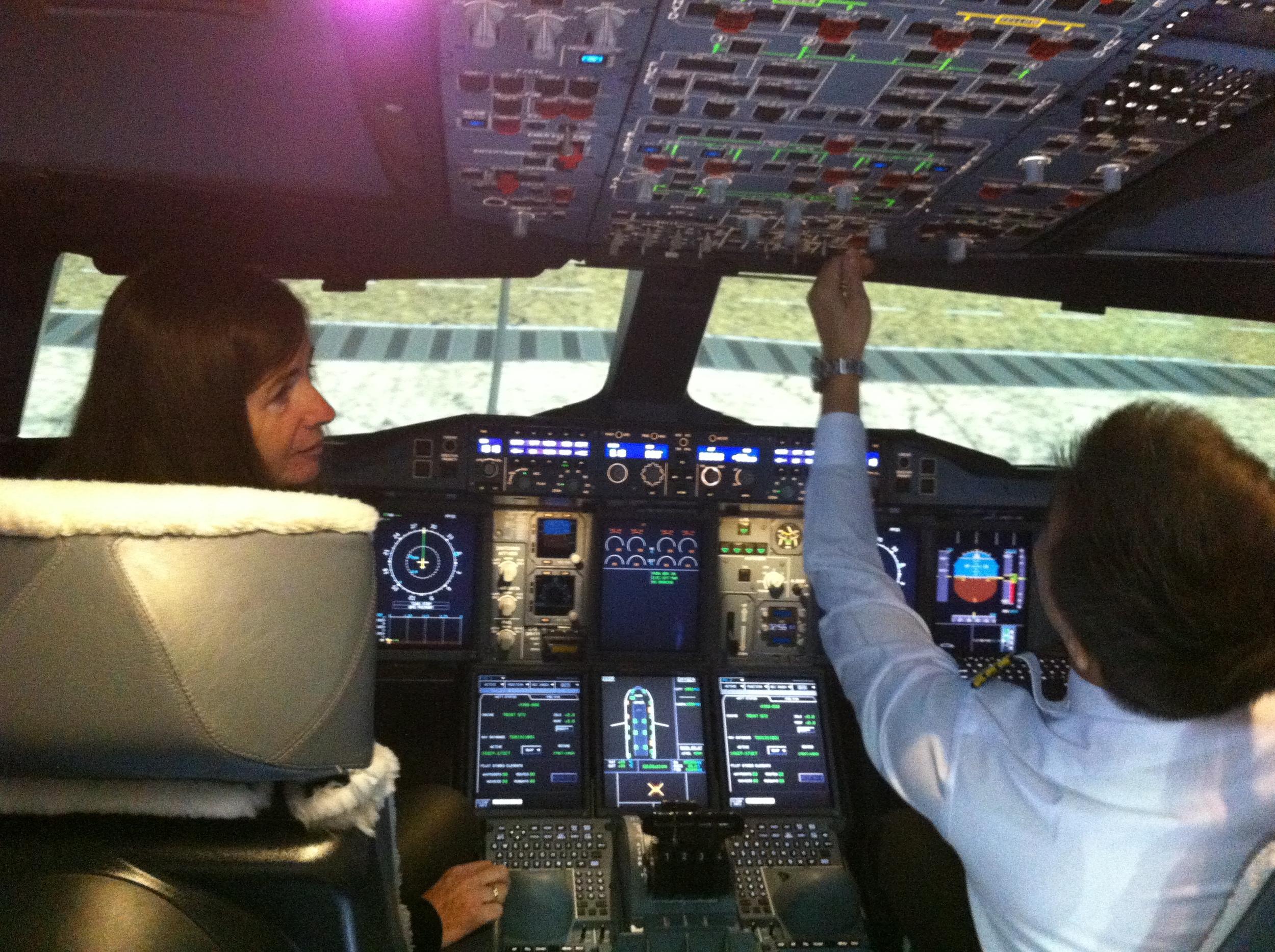 """Preparing for the flight, French blogger Catherine Merveilleux of """" Le Jour et la Nuit """" acting as flight captain"""