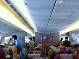 The cabin interior of a Thai Airways Boeing 777-300