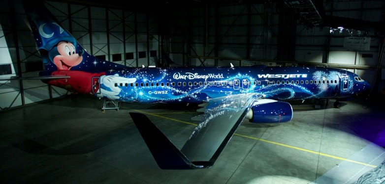 """WestJet and The Walt Disney Company (Canada) have got together to paint a Boeing 737 in """"Magic Kingdom"""" livery. Picture:   WestJet"""