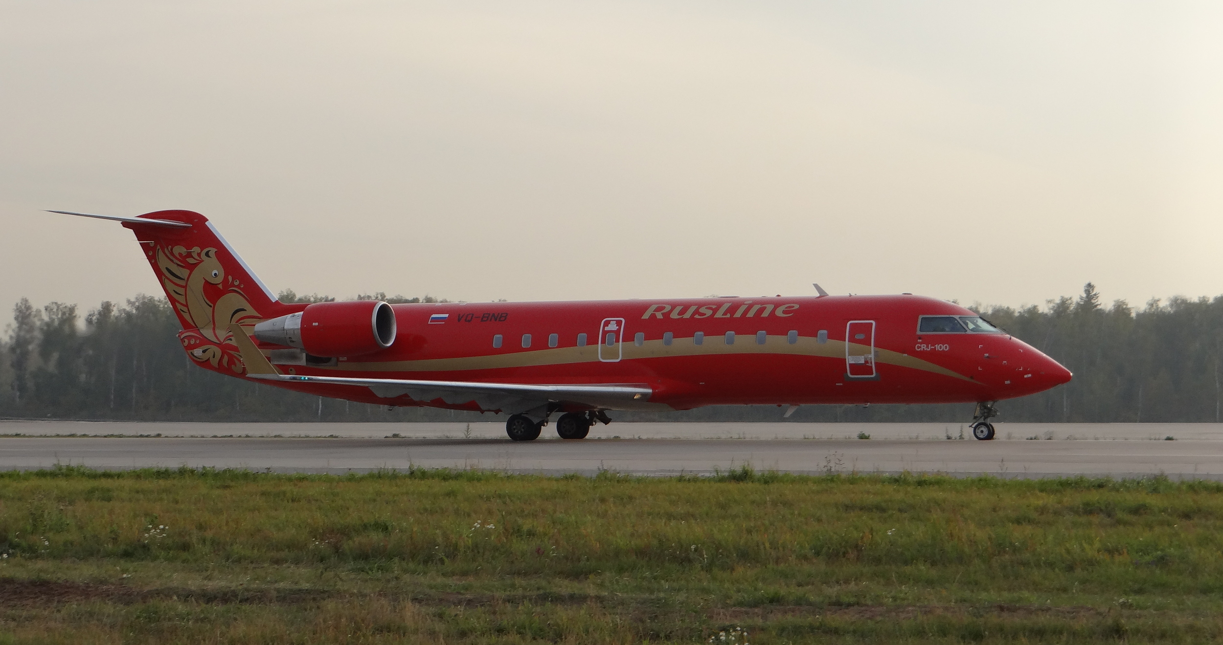 Rusline  is a regional airline, recognizable because of its red livery embroidered with golden Russian folk motives