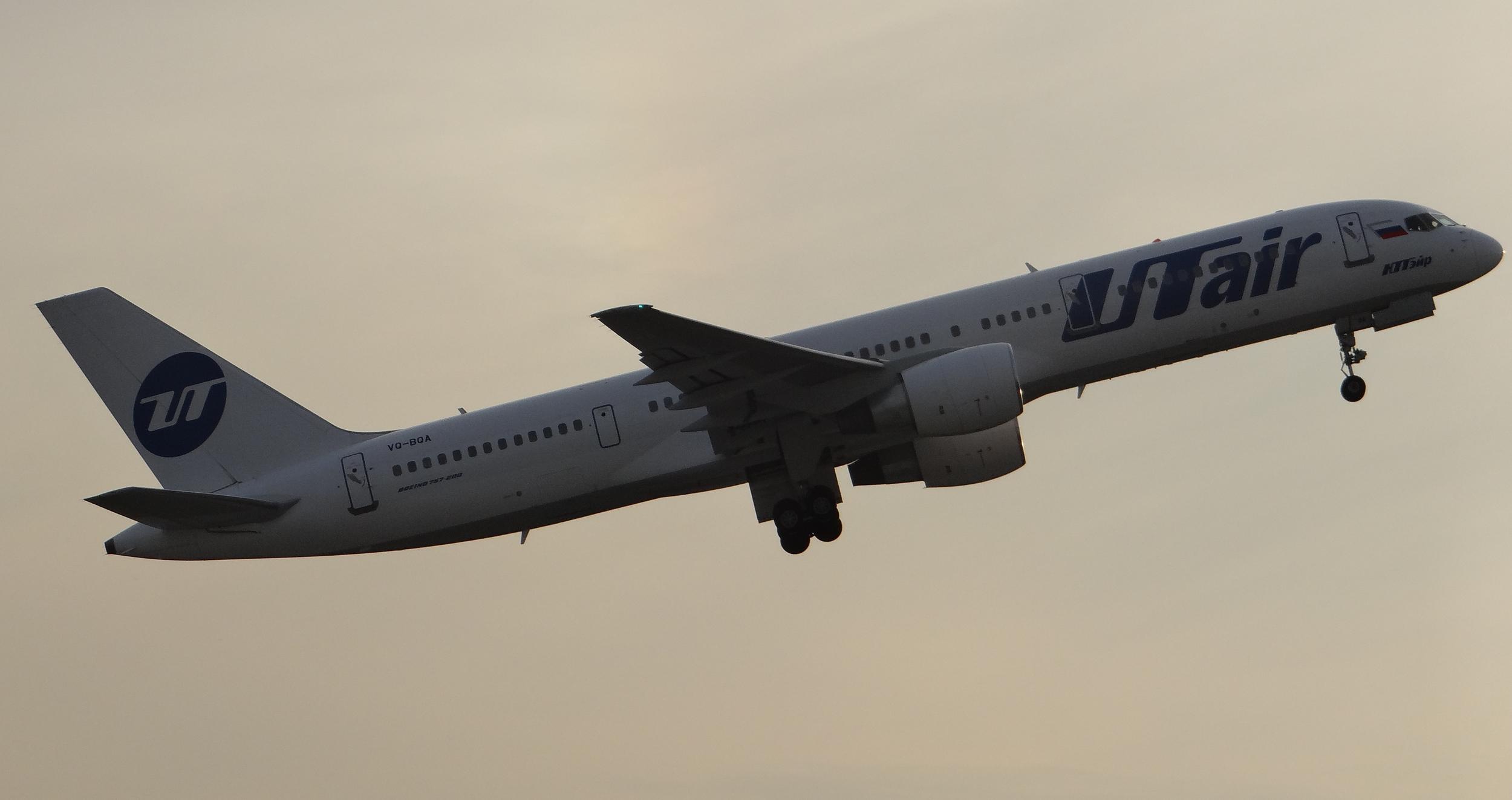 UTair Boeing 757 taking off at sunset