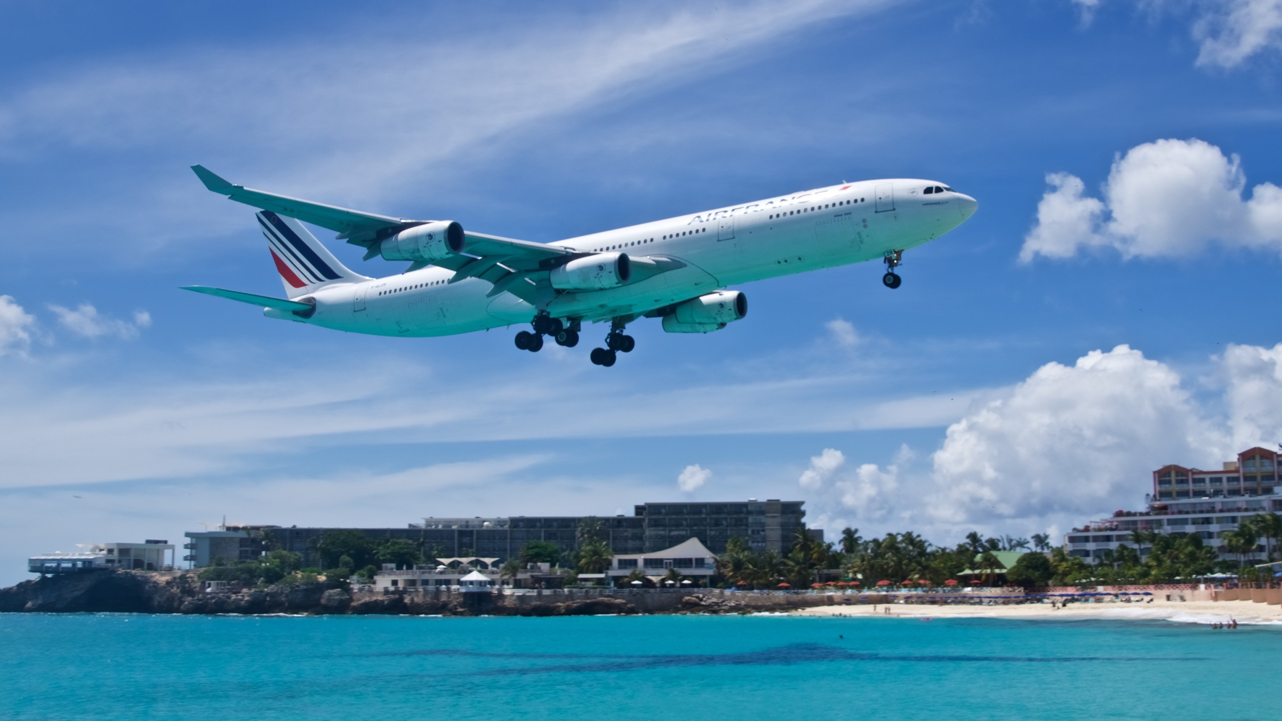 The view from the Sunset Bar & Grill, opposite is the Sonesta Ocean Point Resort, that boasts several panoramic terraces with views towards the airport approaches. Here pictured is the Air France daily flight from Paris, one of the most awaited moments by the spotters on Maho Beach. Picture:  Alain Duzant