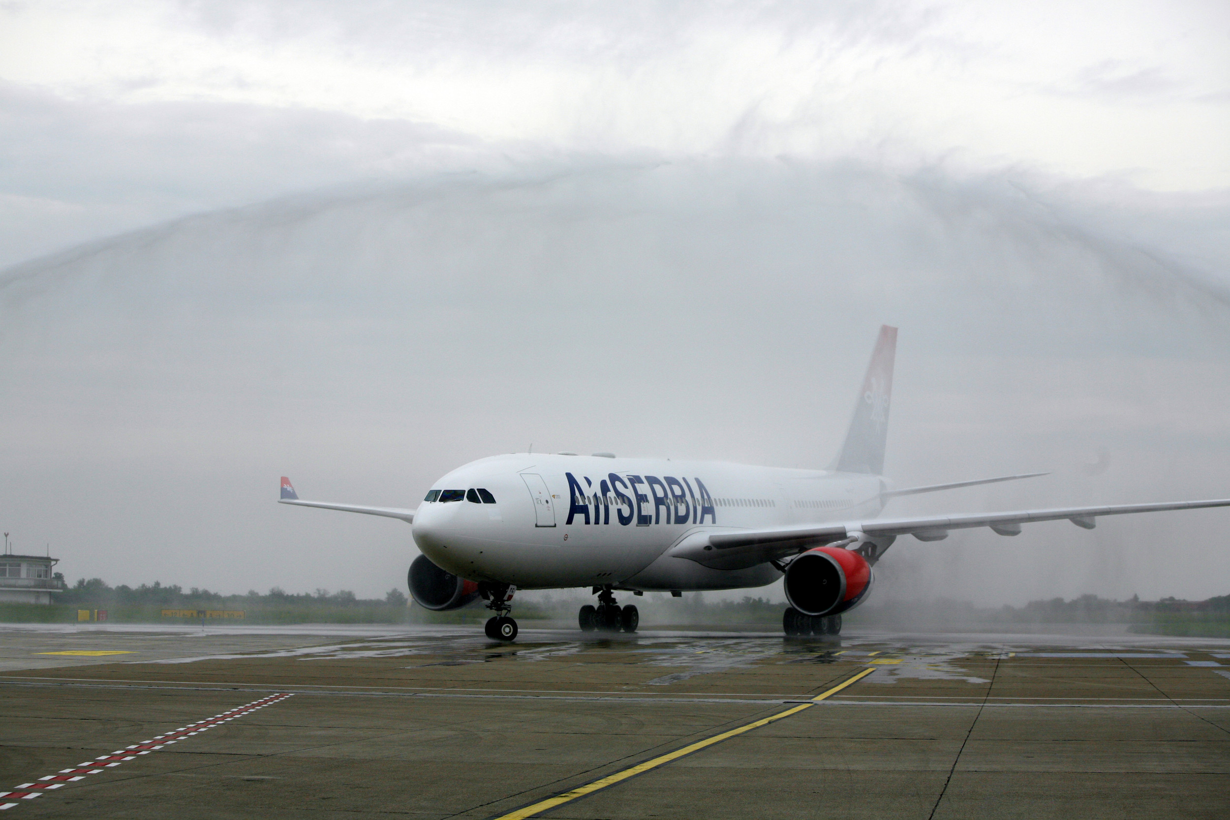The first Airbus A330 aircraft to enter Air Serbia's fleet is greeted by a traditional water cannon salute upon arrival at Nikola Tesla Airport. Picture: Air Serbia