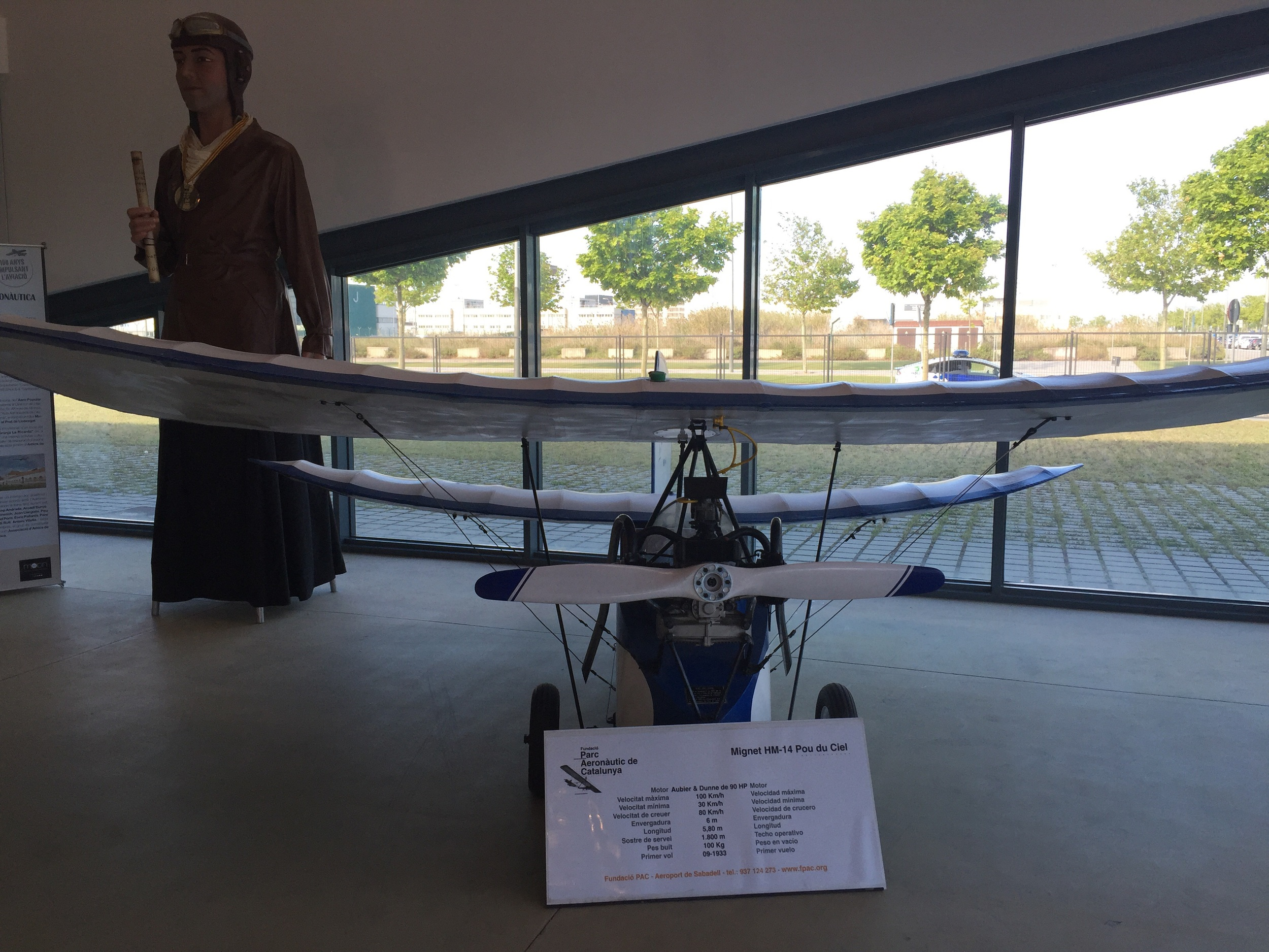 """The tiny aircraft in the foreground is a Mignet """"Pou du Ciel"""", literally """"Flying flea"""", a 1930s design that really caught my eye. On the background is a traditional """"gegant"""", typical of Catalonia's folklore, in aviator's costume."""