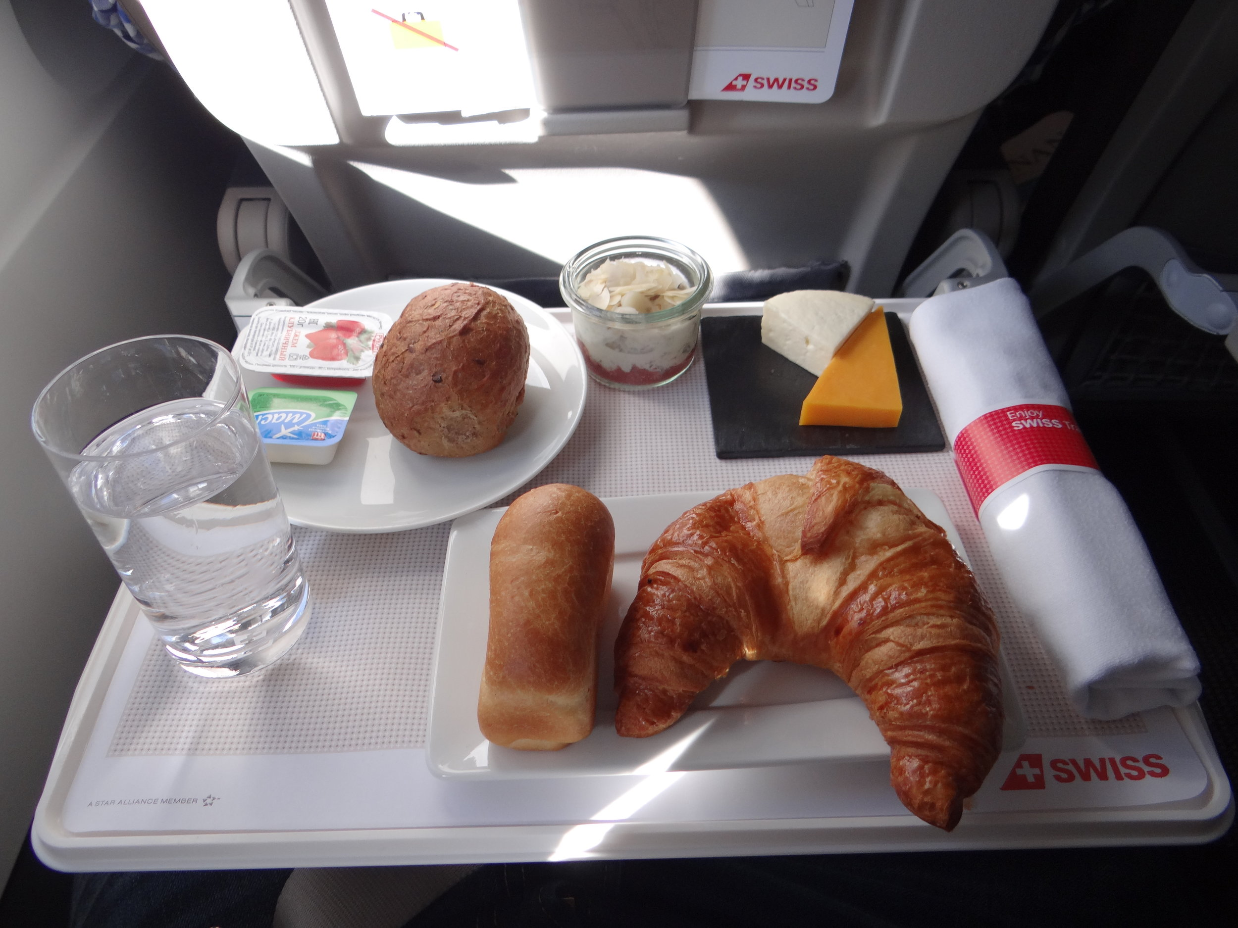 Food and service is, indeed, better than in economy - I had already grab some appettizers at the lounge, so I declined the warm breakfast - croissants were excellent, though, and best of all was the cheese, served in a slate plate