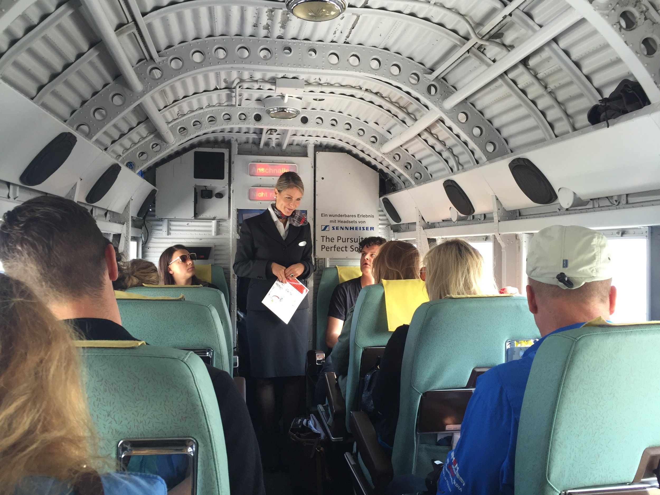 In case you were wondering, here's how the cabin looks like and, yes, just like on any other airliner, there is a flight attendant too