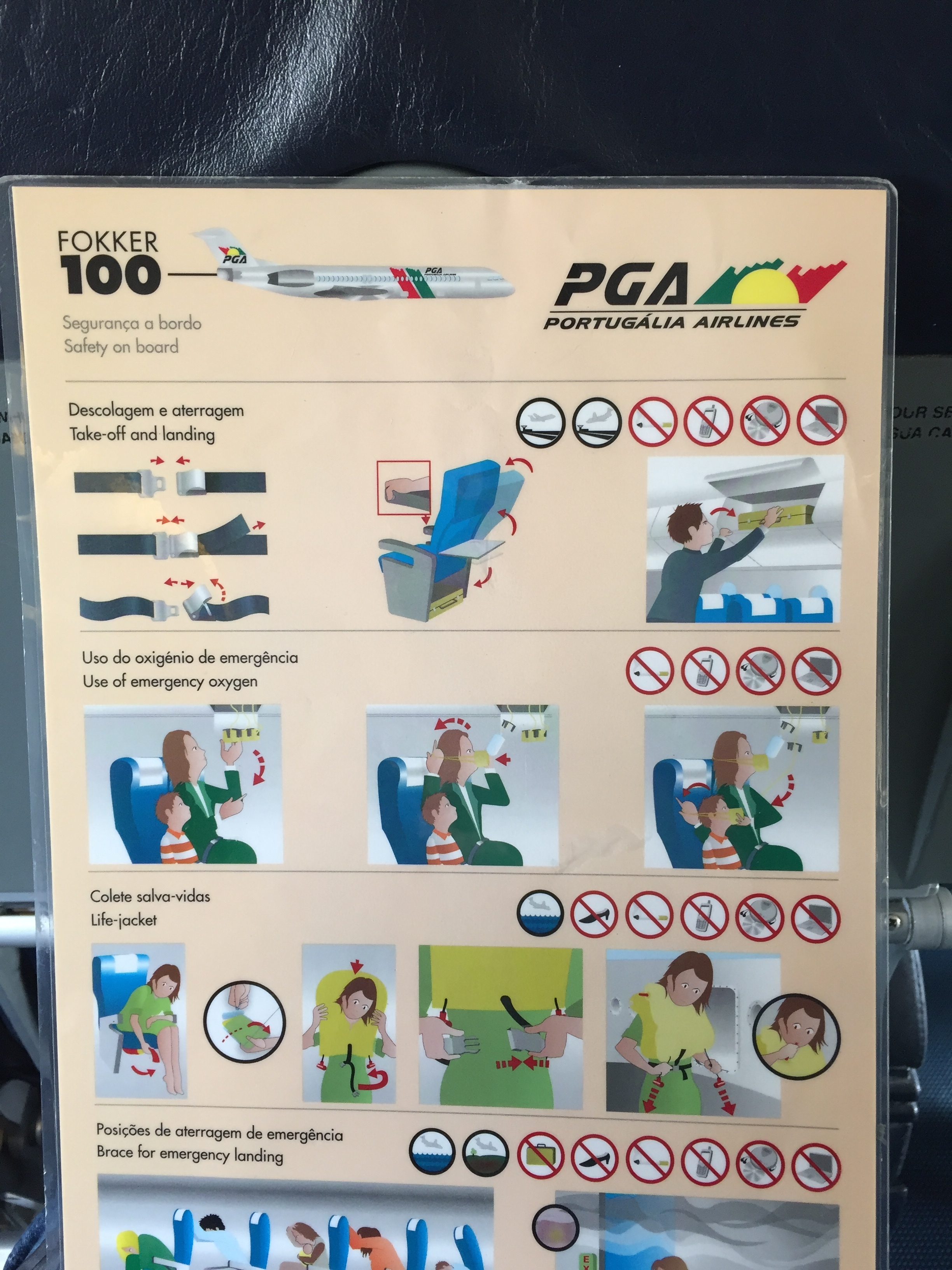 A Portugalia Fokker 100 safety card - I guess this is now a collector's item...