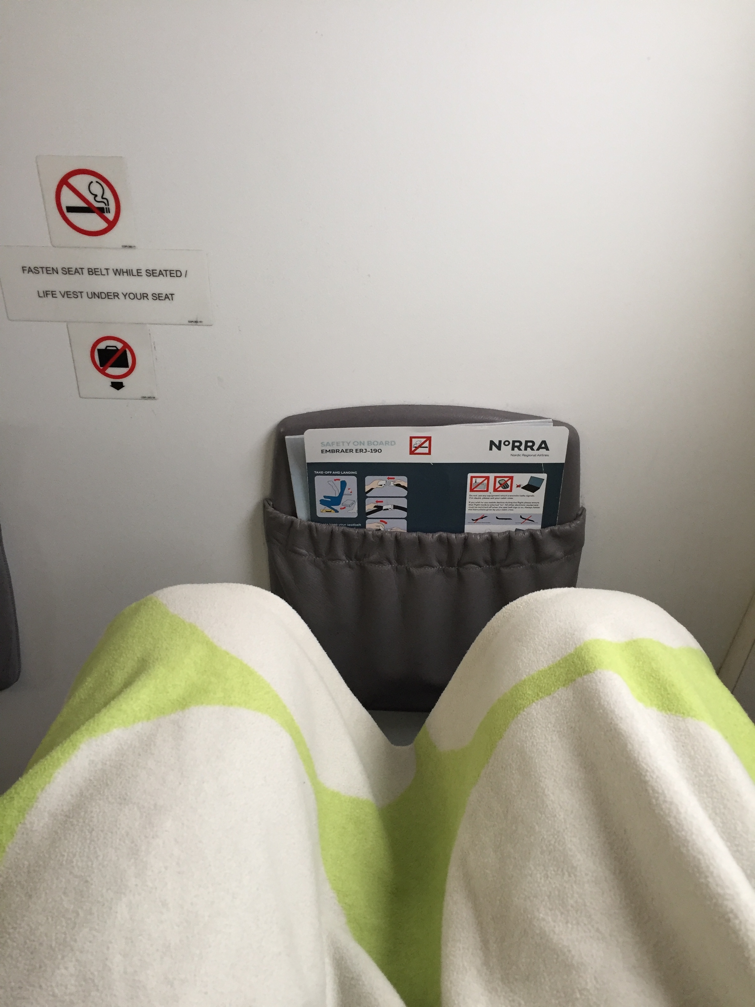 I went to see whether there was more space in the front row, actually, there wasn't! In fact, it was not possible for me to fully stretch the legs, so, as the business class section was only half full, I took another seat a bit behind