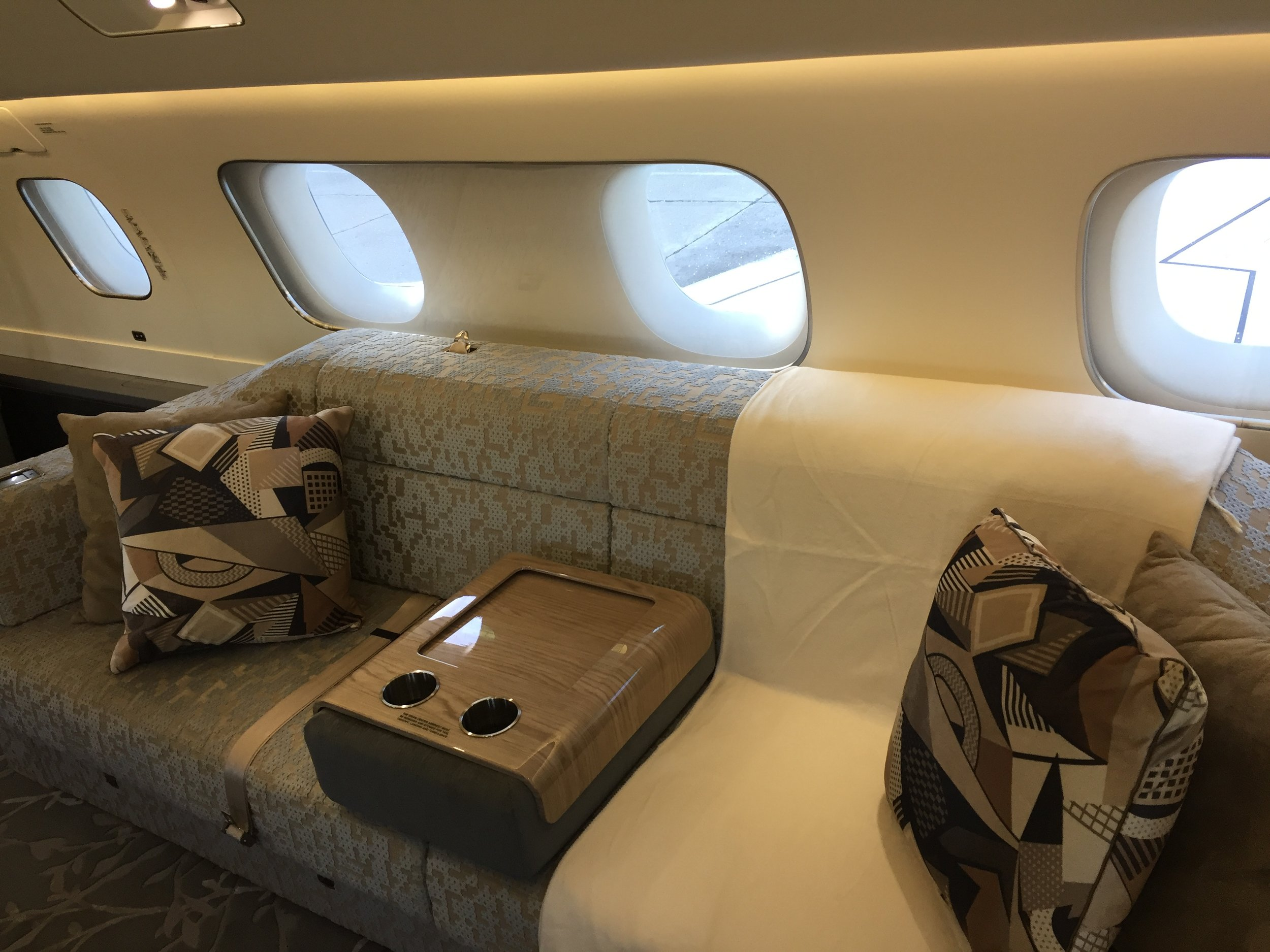 There is also a sofa towards the middle of the cabin