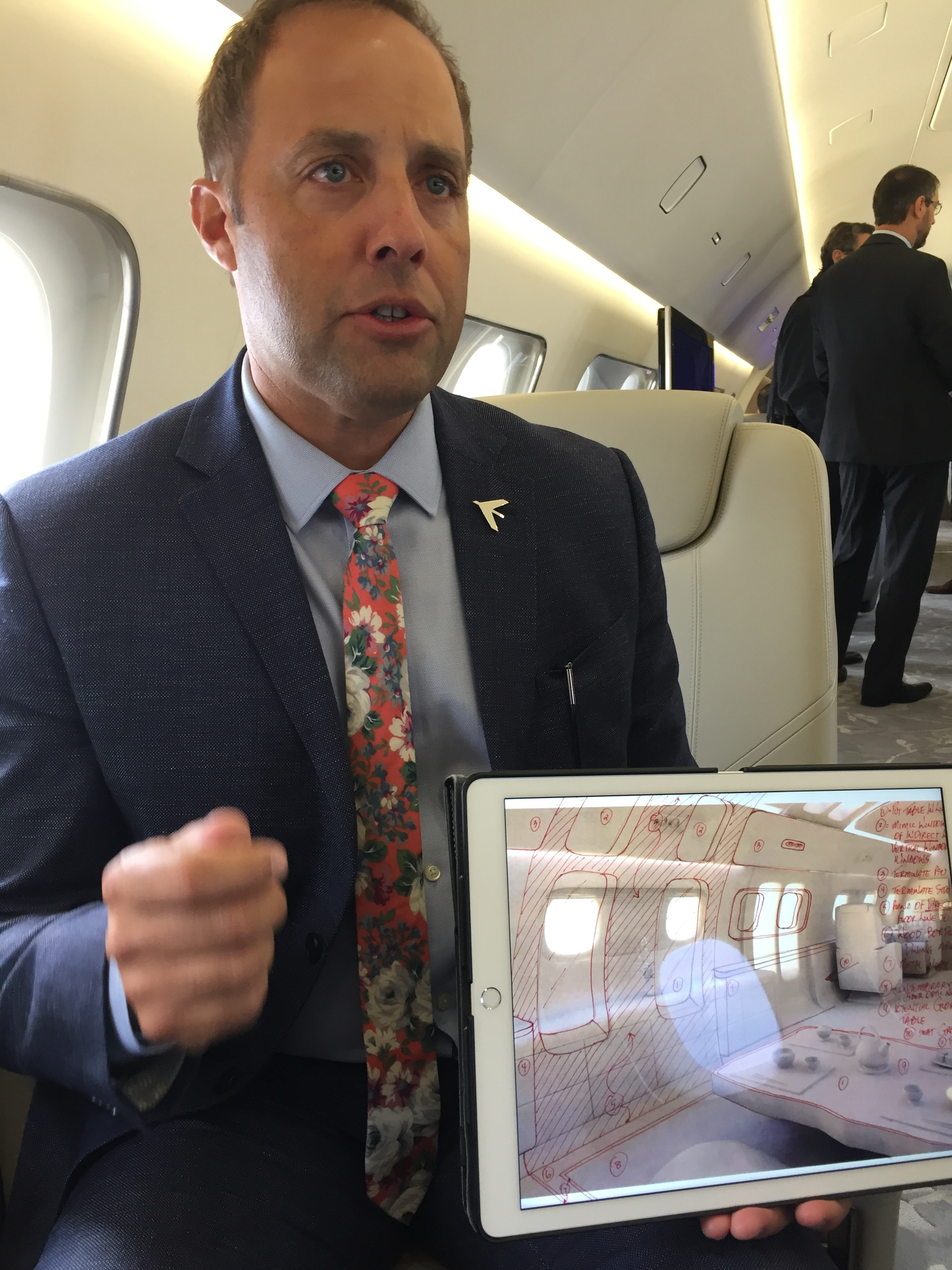 """Here, Jay Beever, Embraer's head of design shows a sketch of the """"Kyoto"""" cabin concept, a Japan-themed truly original cabin concept with oversized windows and Japanese tatamis"""