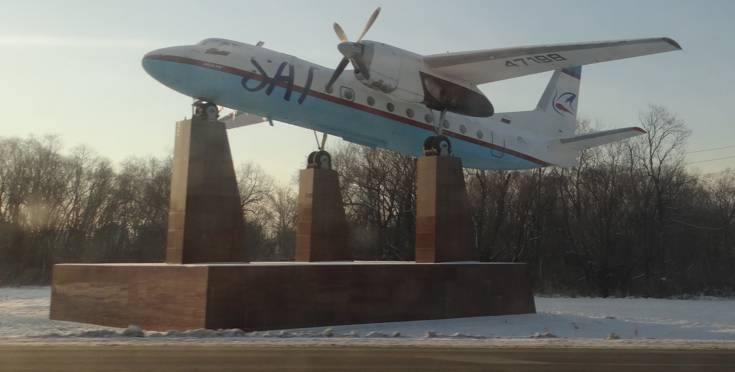 Just outside Yuzhno-Sakhalinsk airport, an Antonov An-24 in the livery of local airline SAT, now part of Aurora (Aeroflot Group)