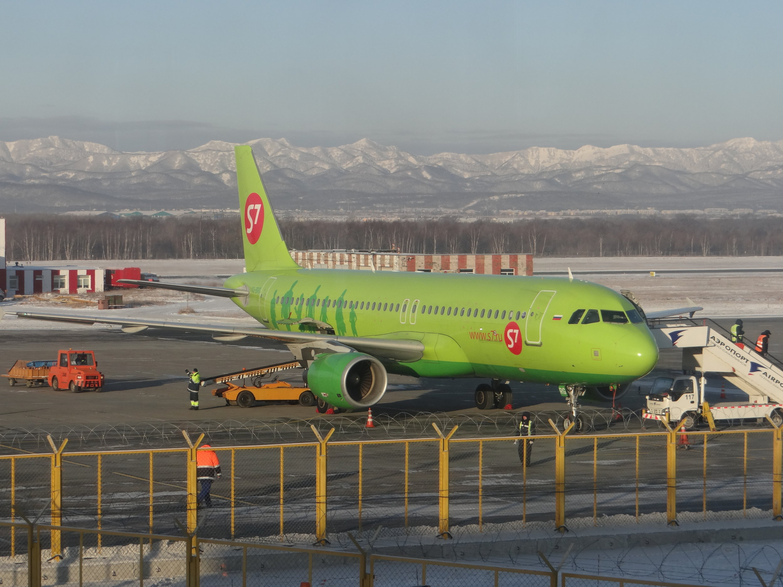 Passengers at Yuzhno-Sakhalinsk can enjoy the majestic landscapes this island has to offer. In the foreground an S7 A320 preparing to depart for Vladivostok, in the mainland