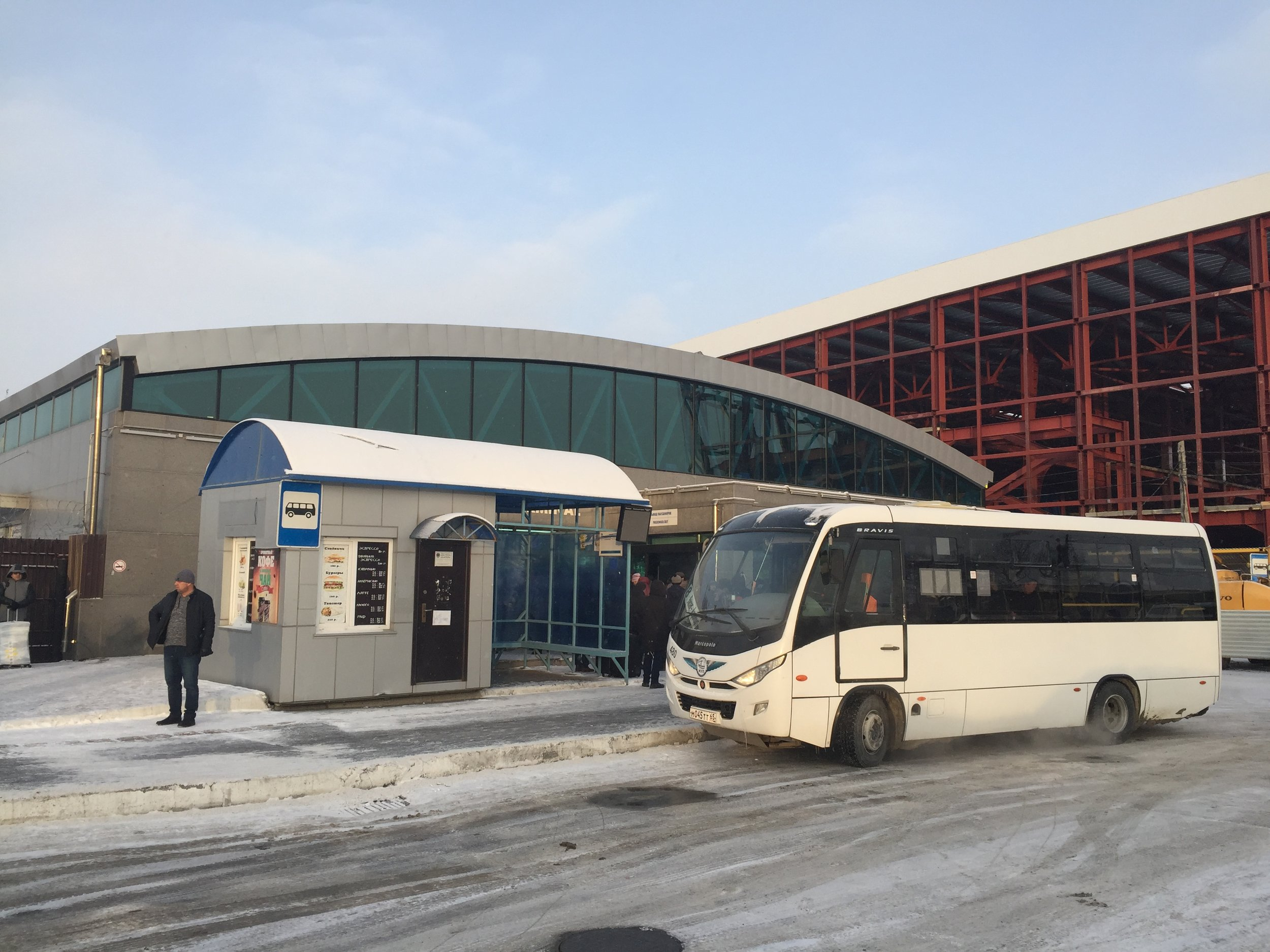 Arrivals area at Yuzhno-Sakhalinsk airport. The new terminal is taking shape next door.