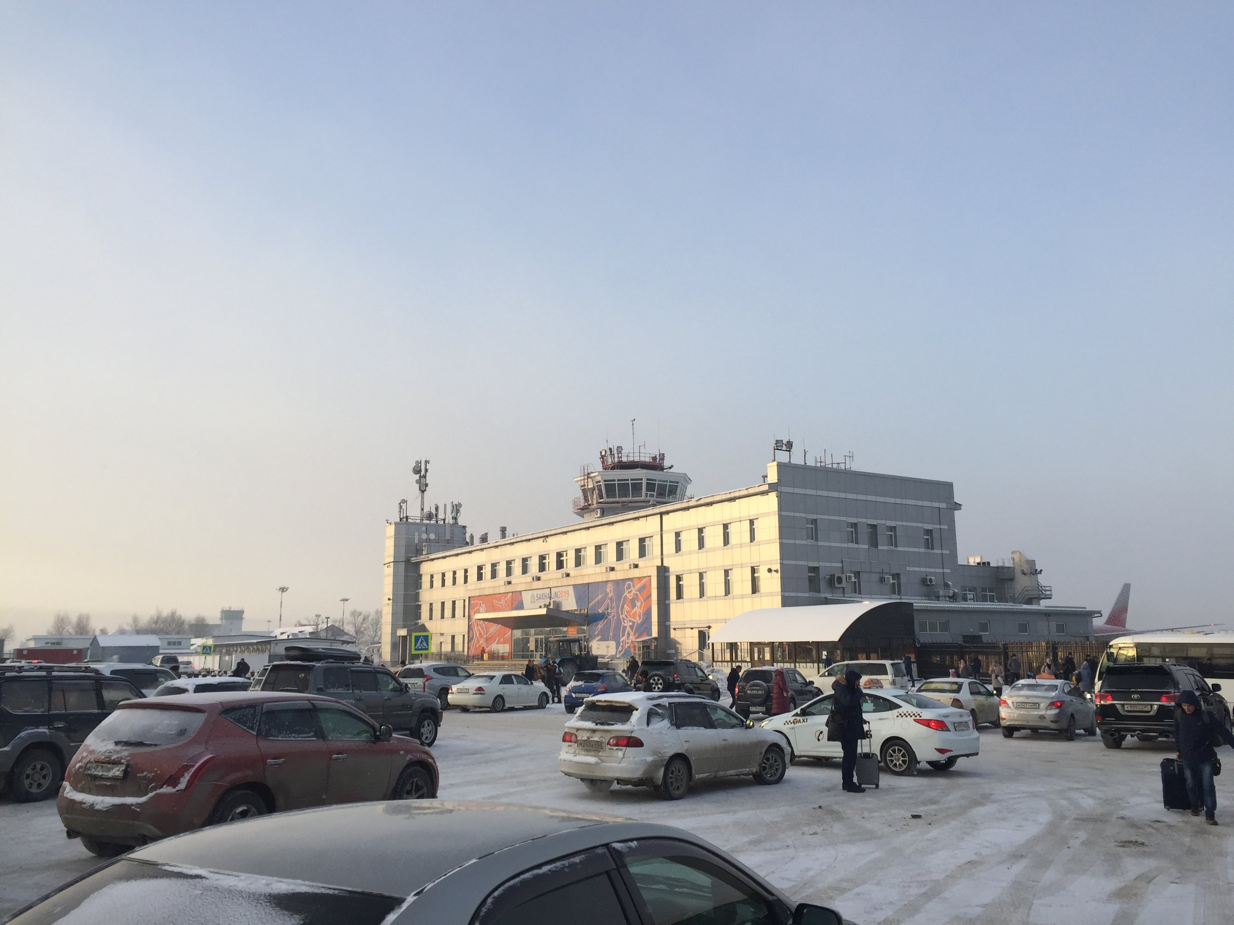 Peak hour at Yuzhno-Sakhalinsk airport: shortly after the arrival of the Rossiya daily Moscow flight, the outside of the terminal filled with cars of people coming to pick up their friends and relatives