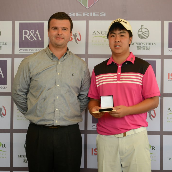 Faldo Series Asia Cambodia champion Putt Sridama of Thailand collects his winner's medal from Angkor Golf Resort director David Baron yesterday. Photo supplied