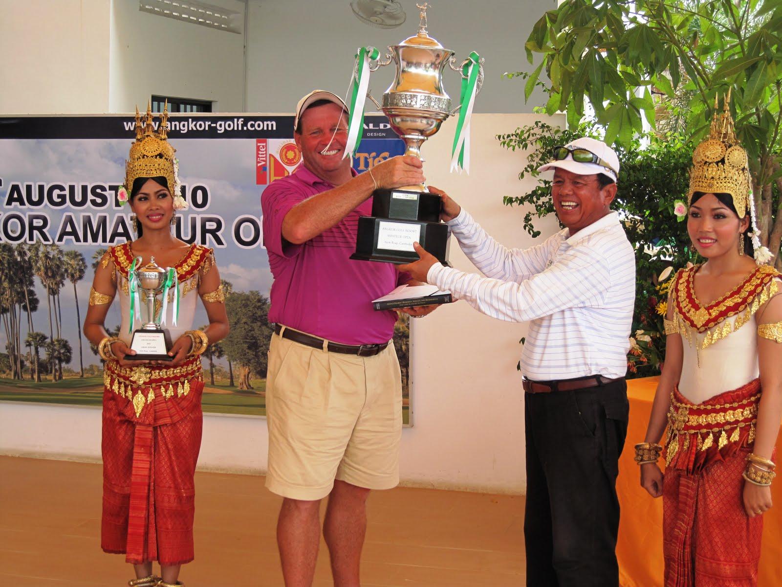 Winner of the Angkor Amateur Open 2010; Scott Puzey receiving trophy from HE Souphirin