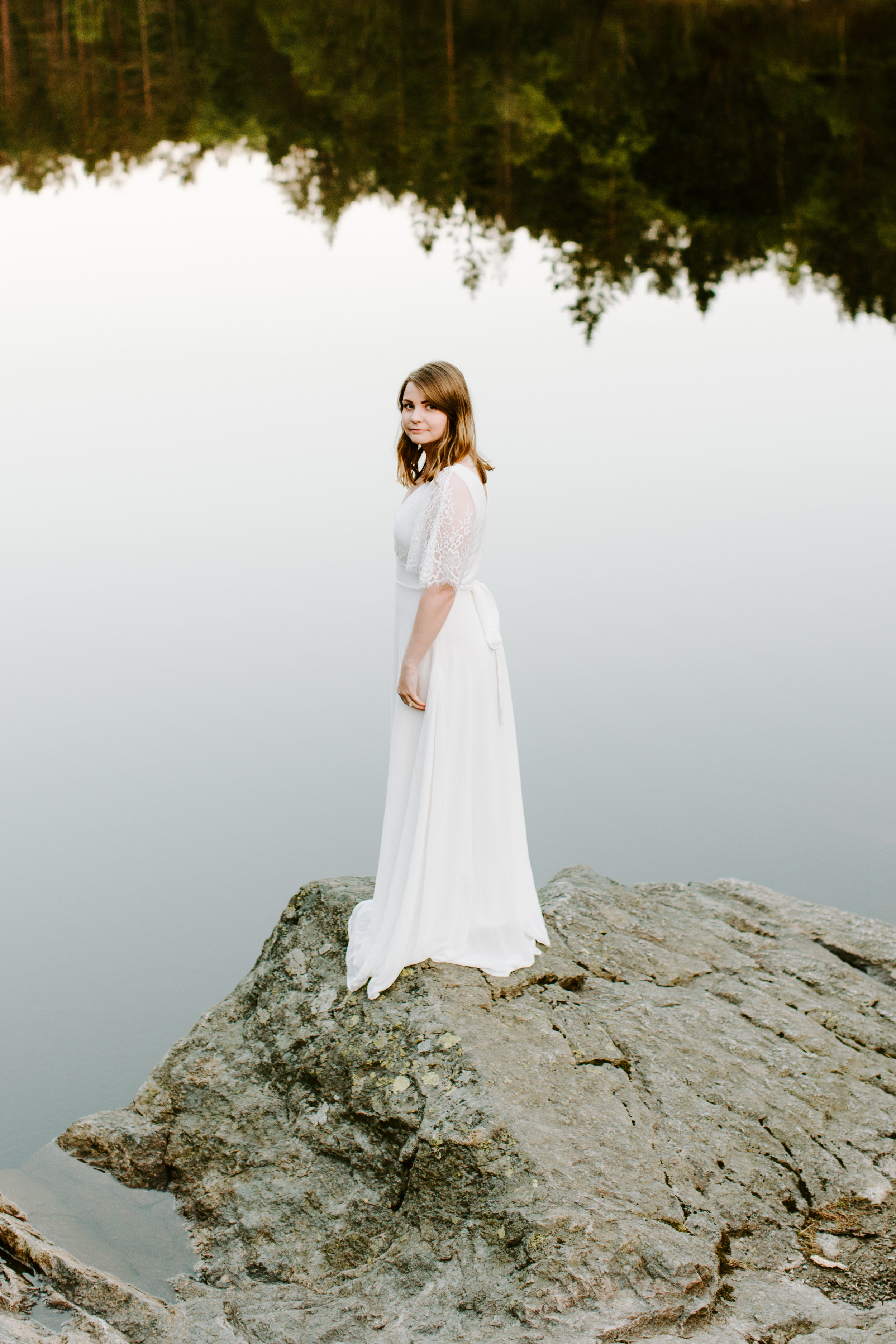 bride looking back by the lake in norway