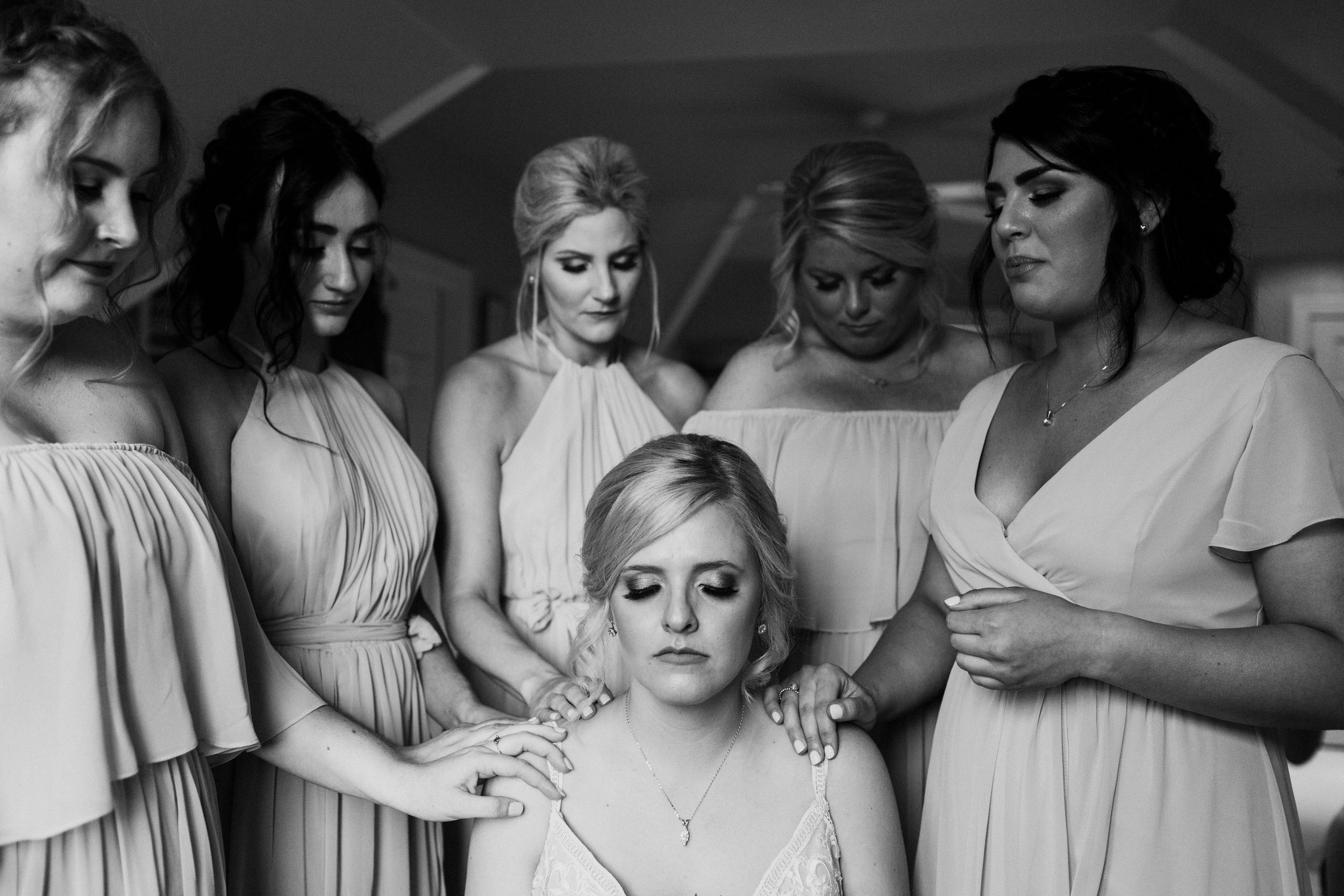 bridesmaids-praying-over-bride.jpg