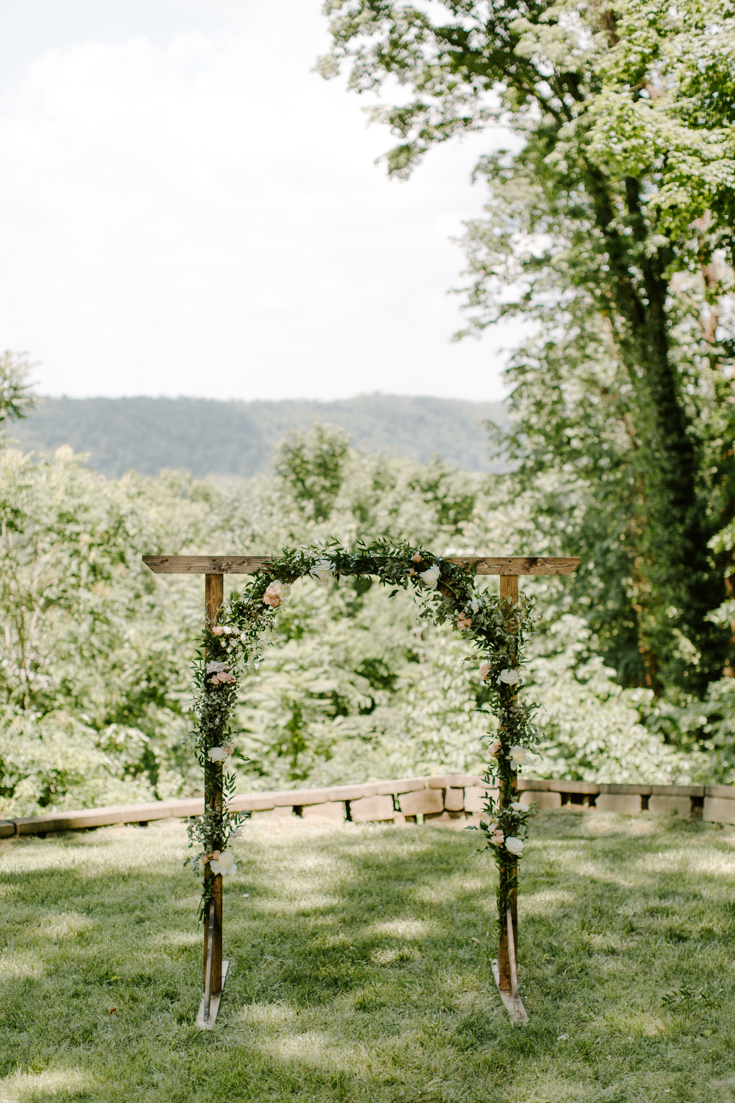 wedding ceremony greenery arch by state and arrow
