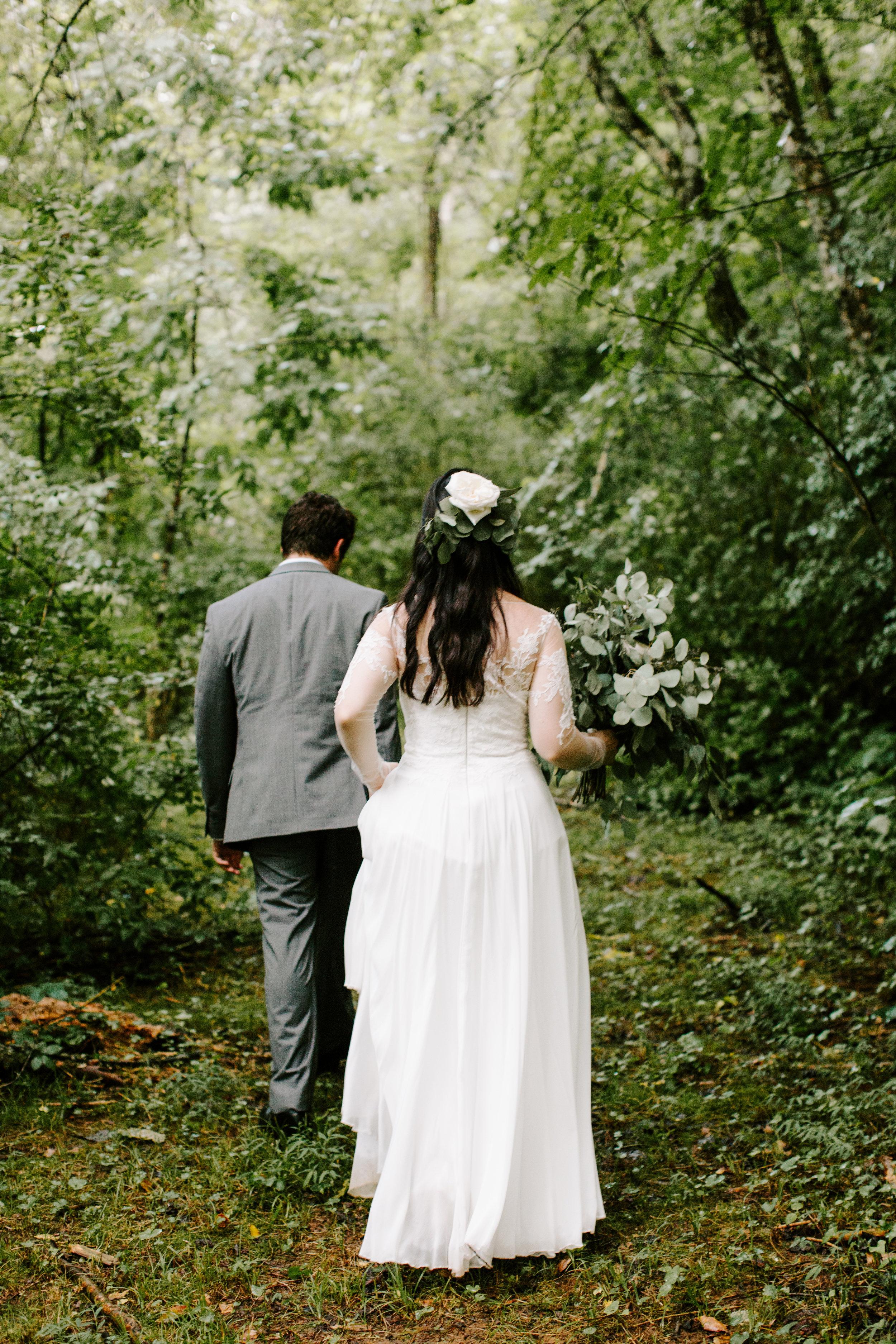 bride-and-groom-walking-into-woods.jpg