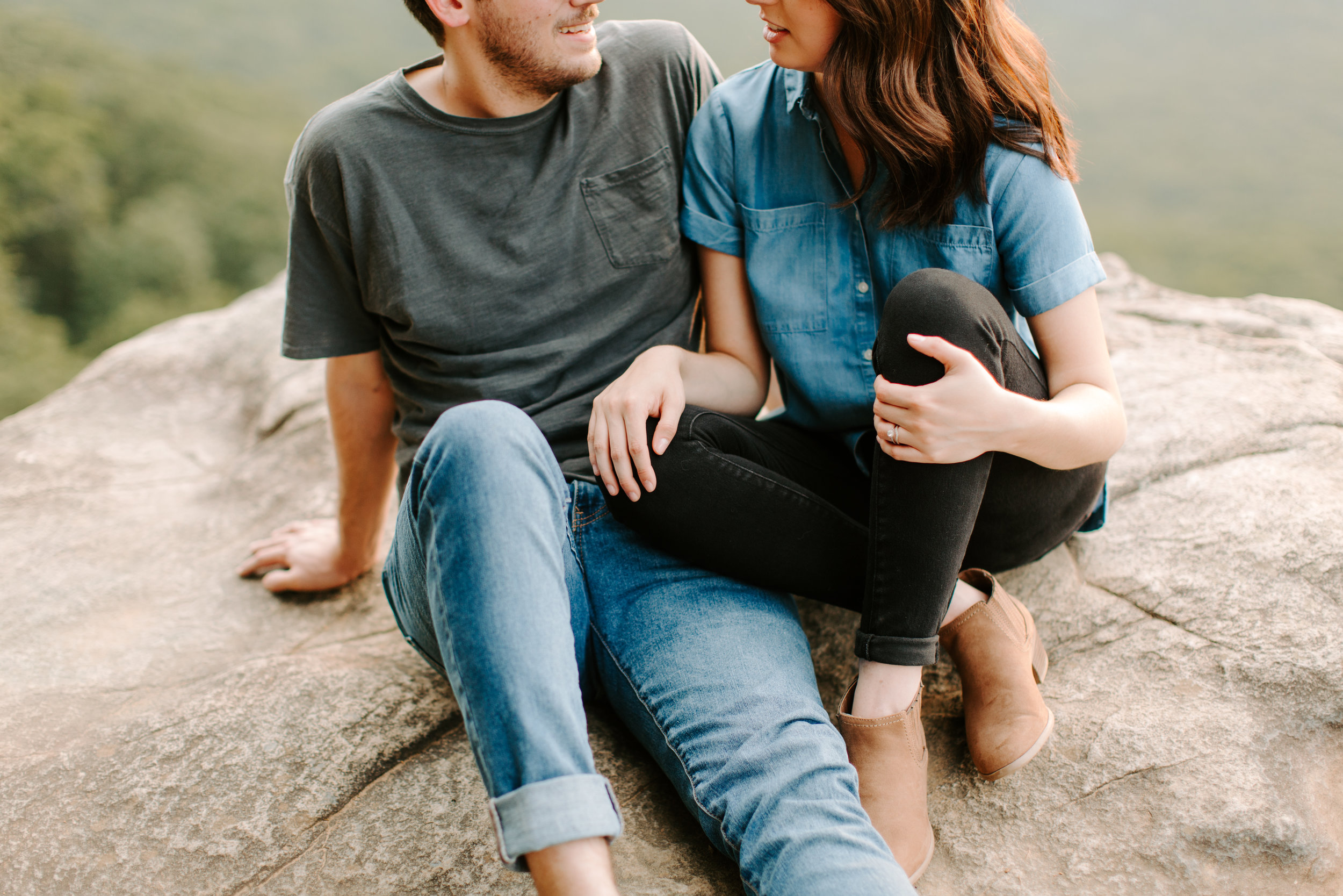 couple sitting on cliff