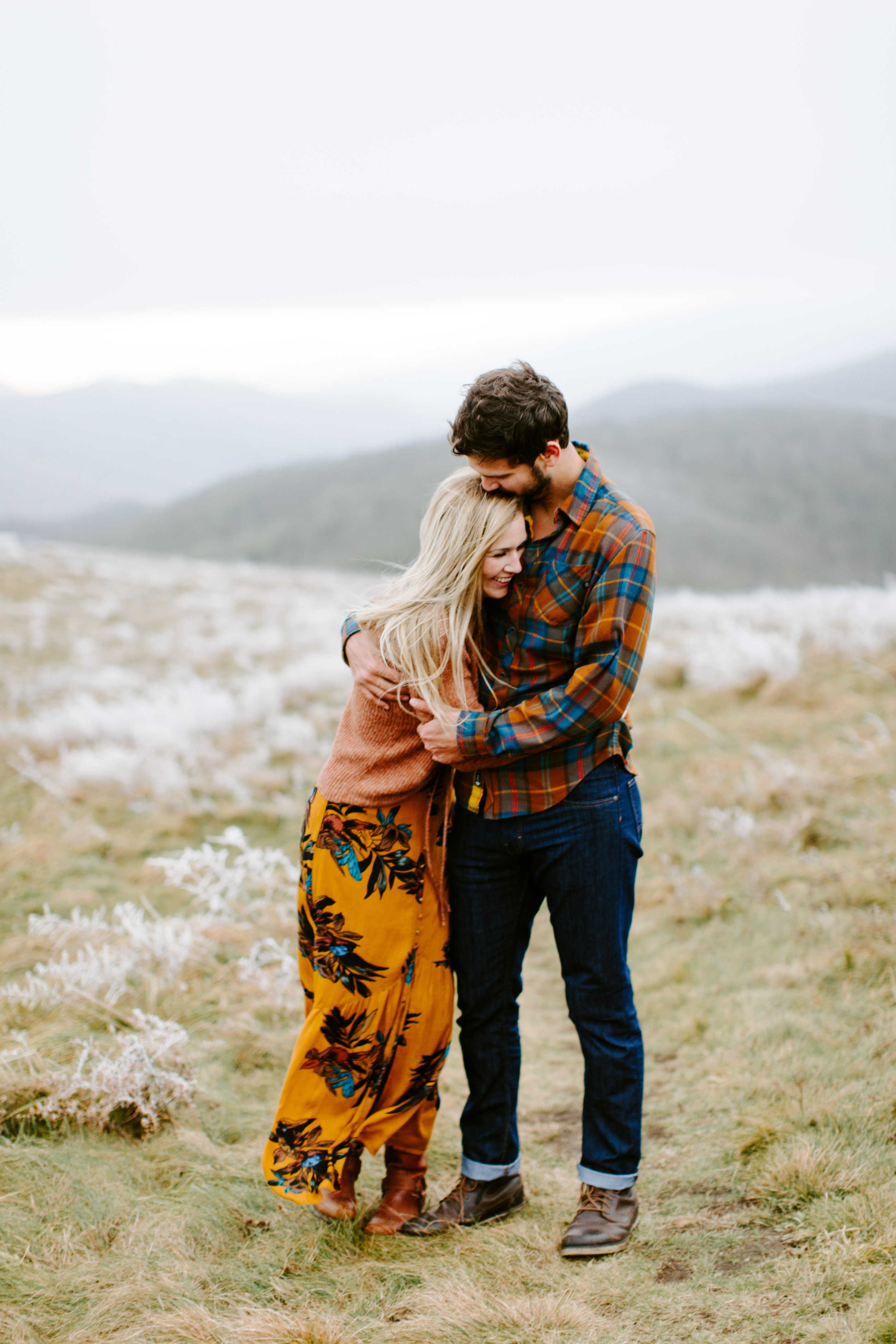 couple hugging in the cold on a mountain