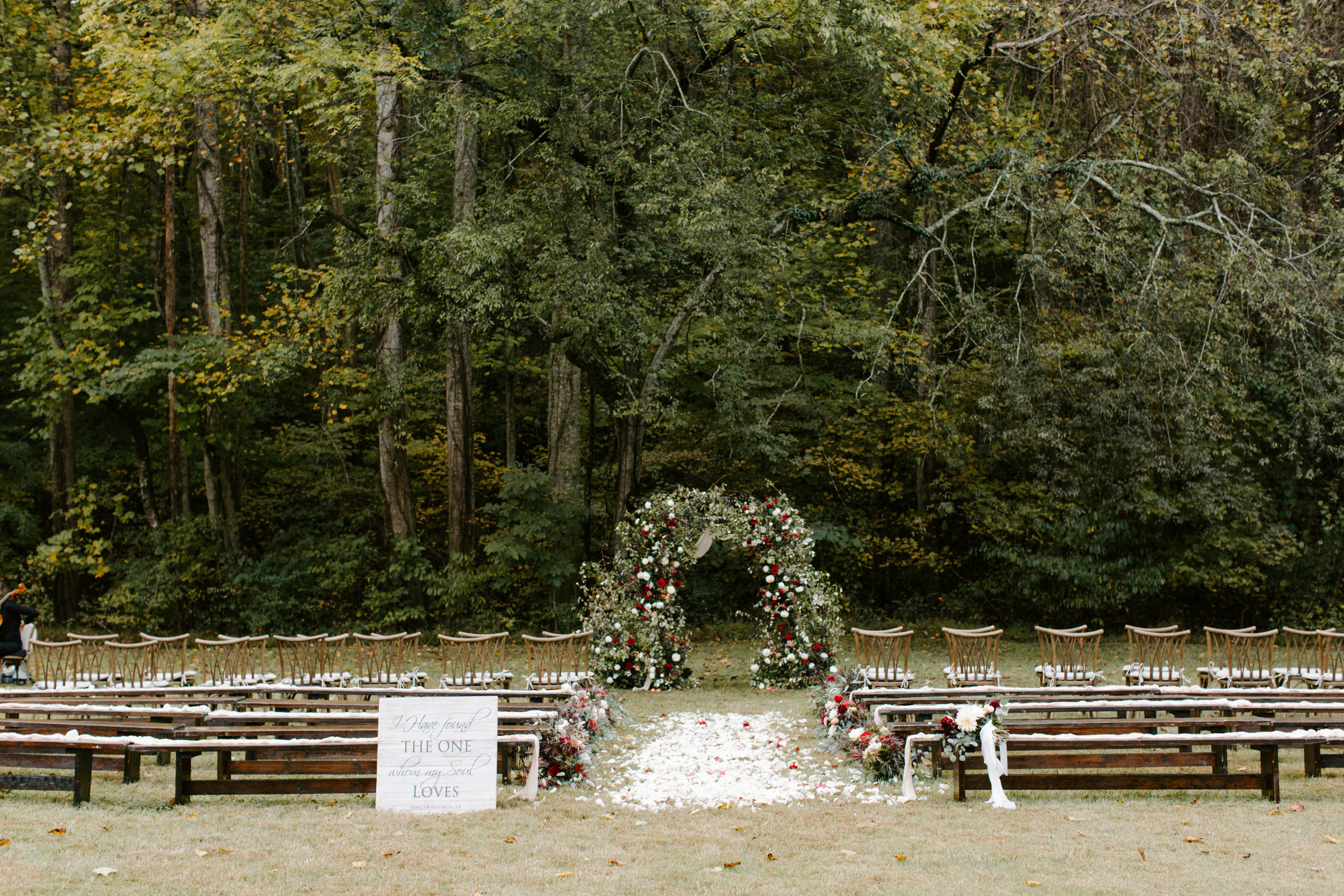 beautiful ceremony setup with a floral arch
