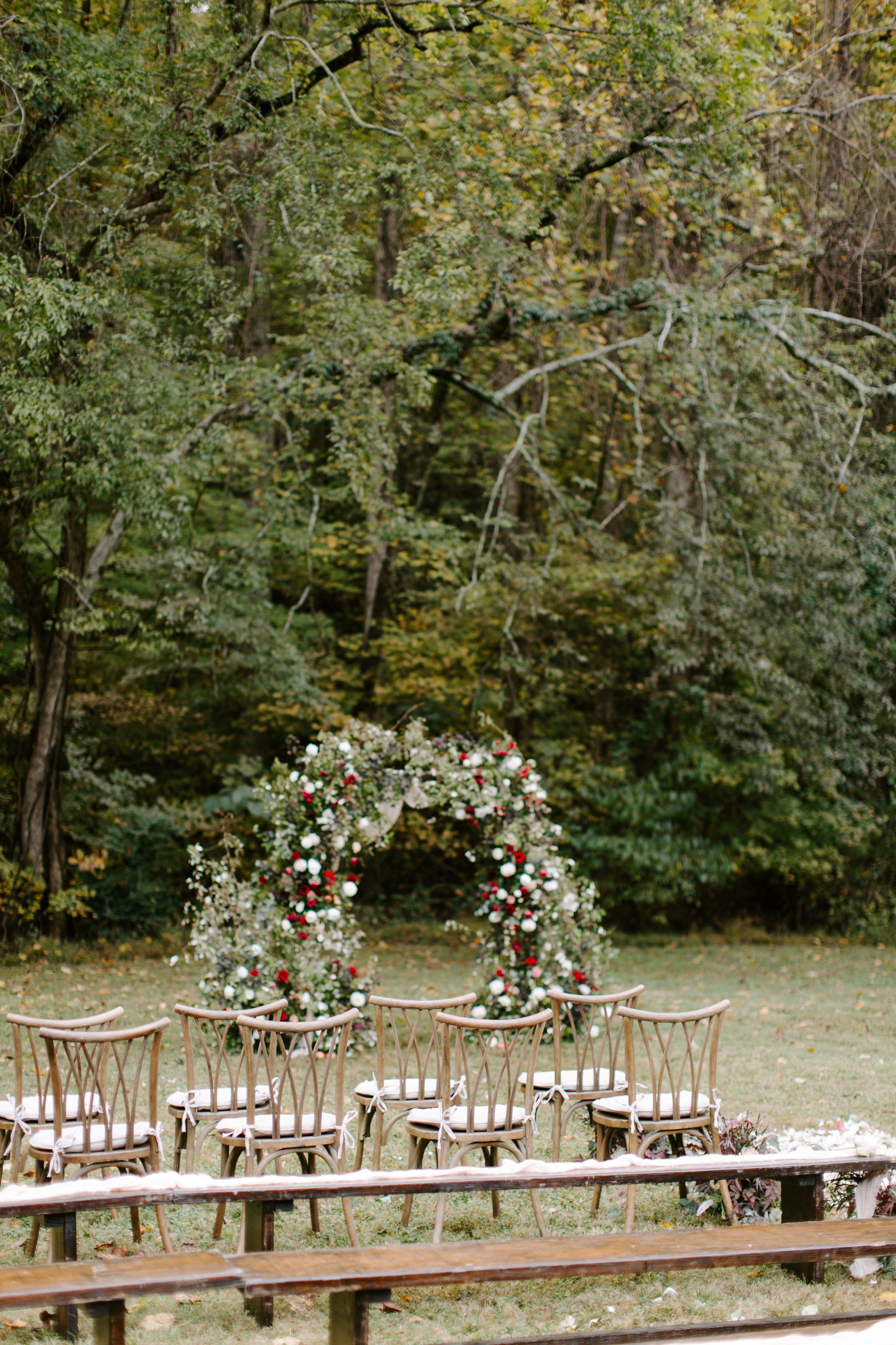 autumn floral arch at a wedding ceremony
