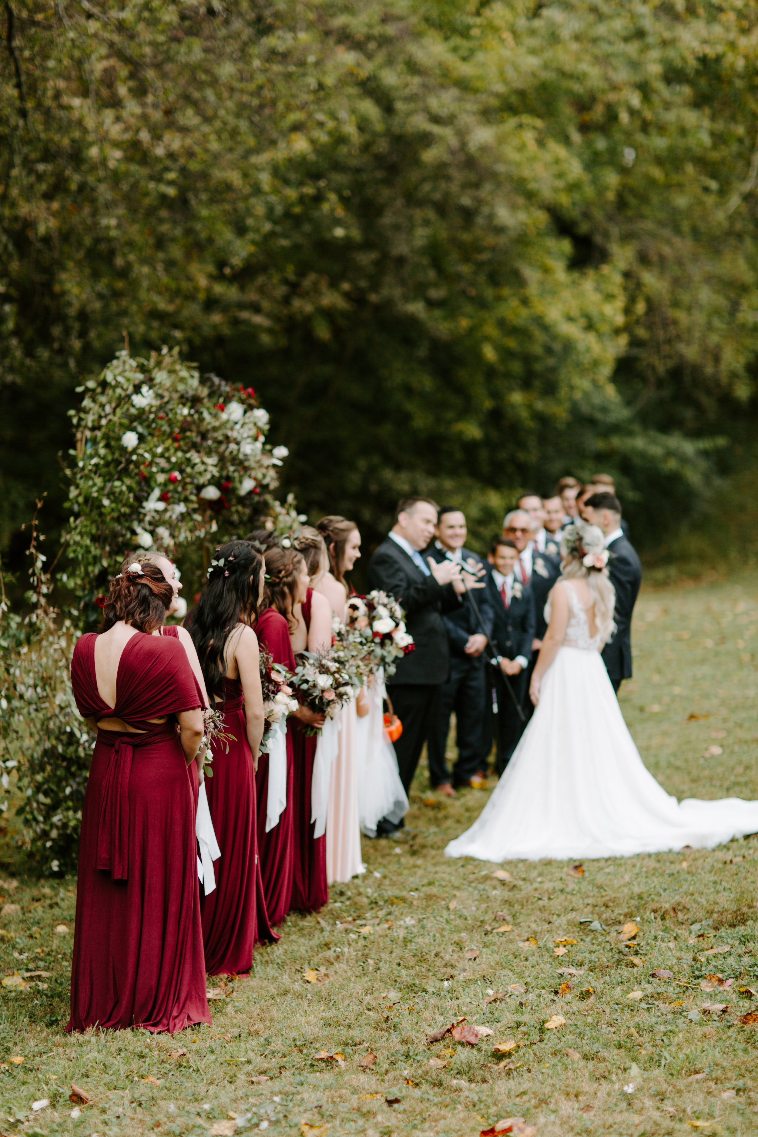 outdoor fall ceremony with gorgeous floral arch