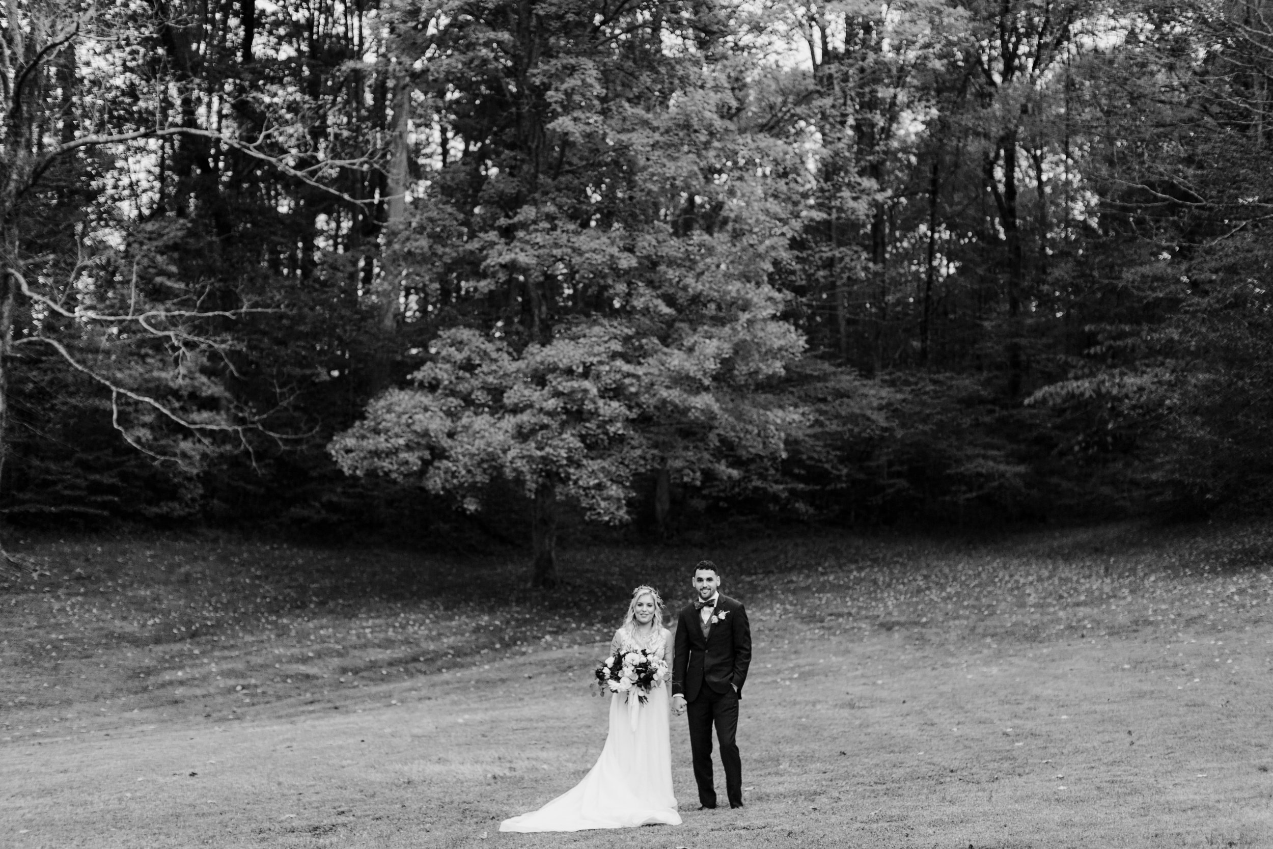 black and white wide shot of bride and groom
