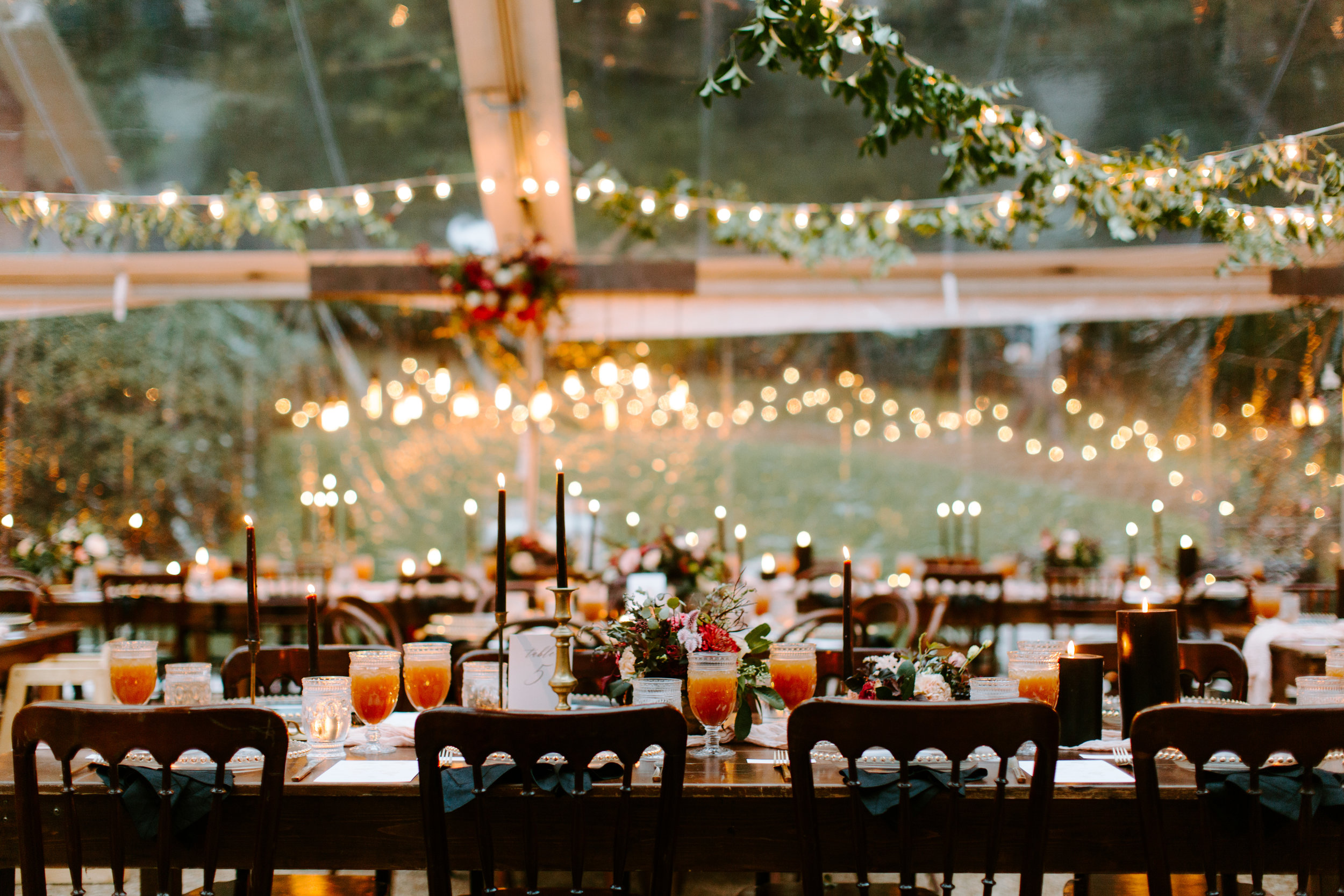 string lights under a clear tent for the reception