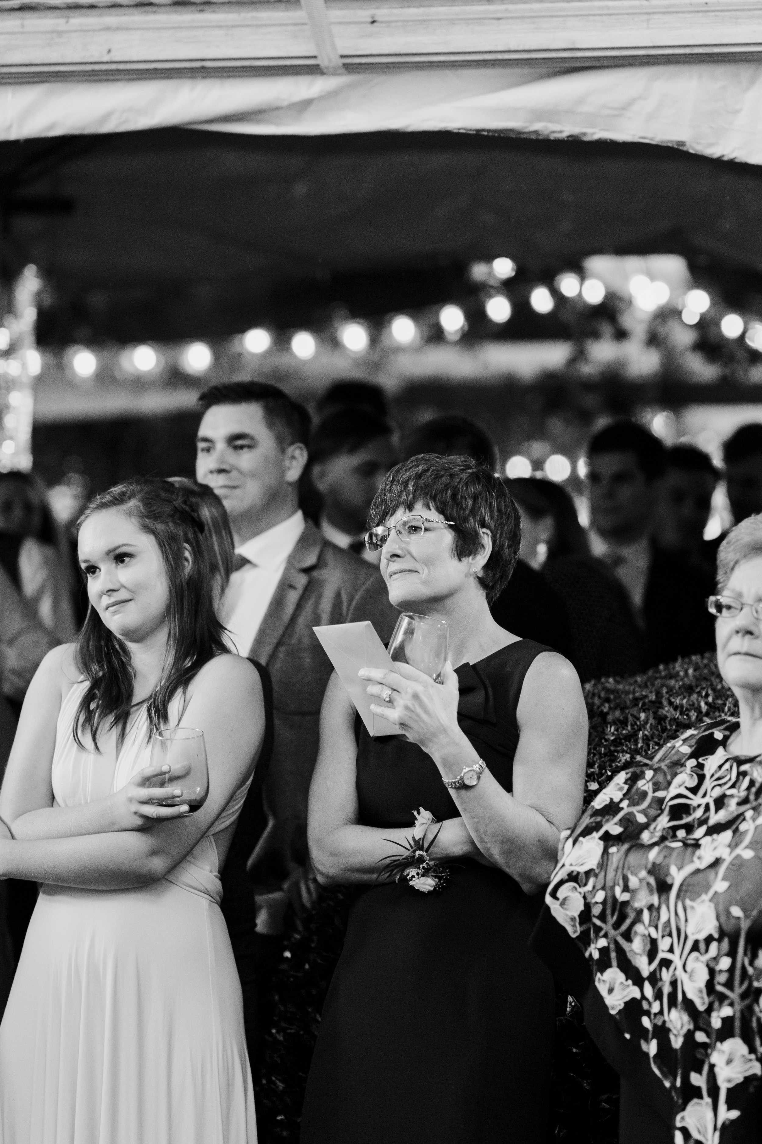 mom watching daughter dance with dad