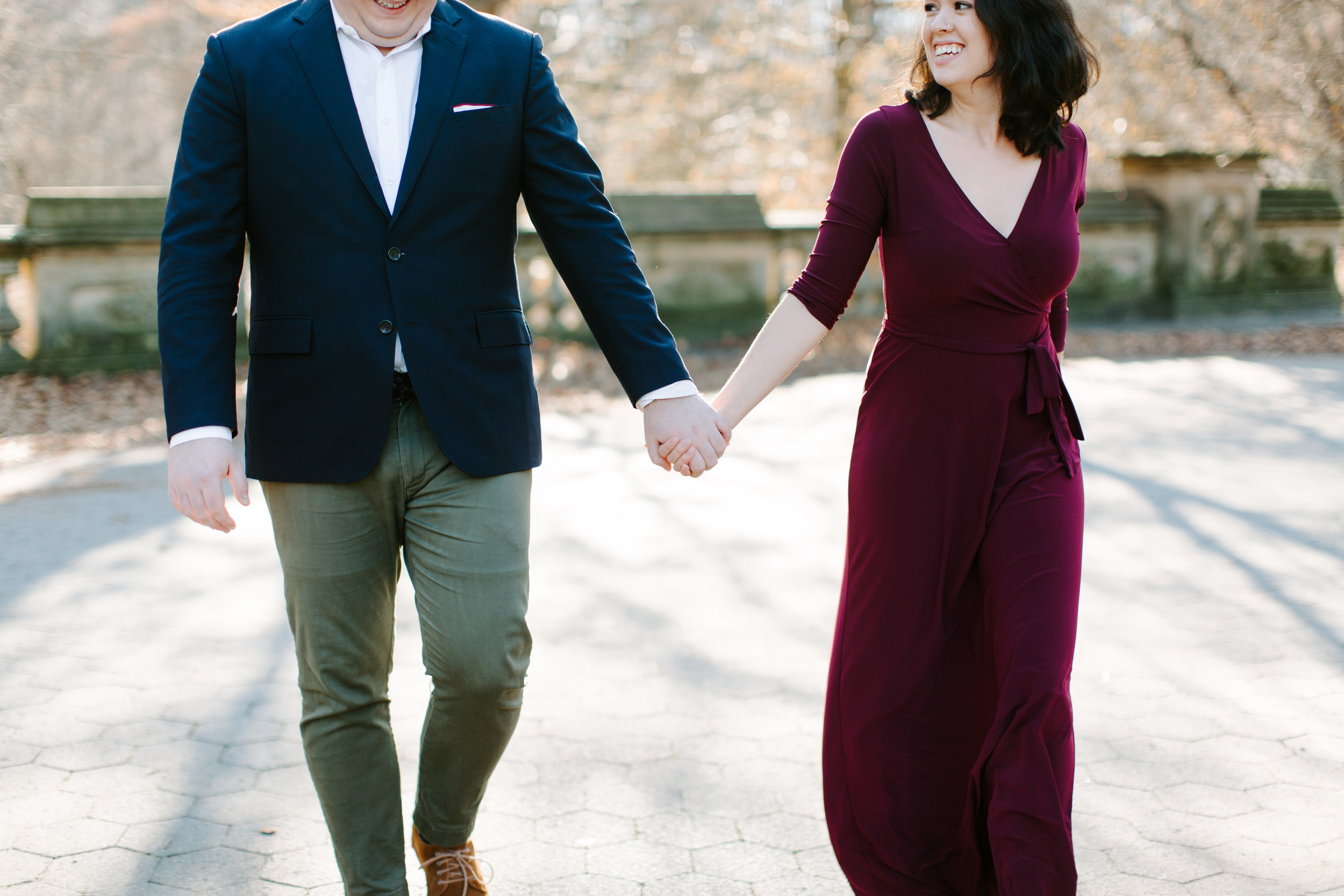 couple walking through central park holding hands