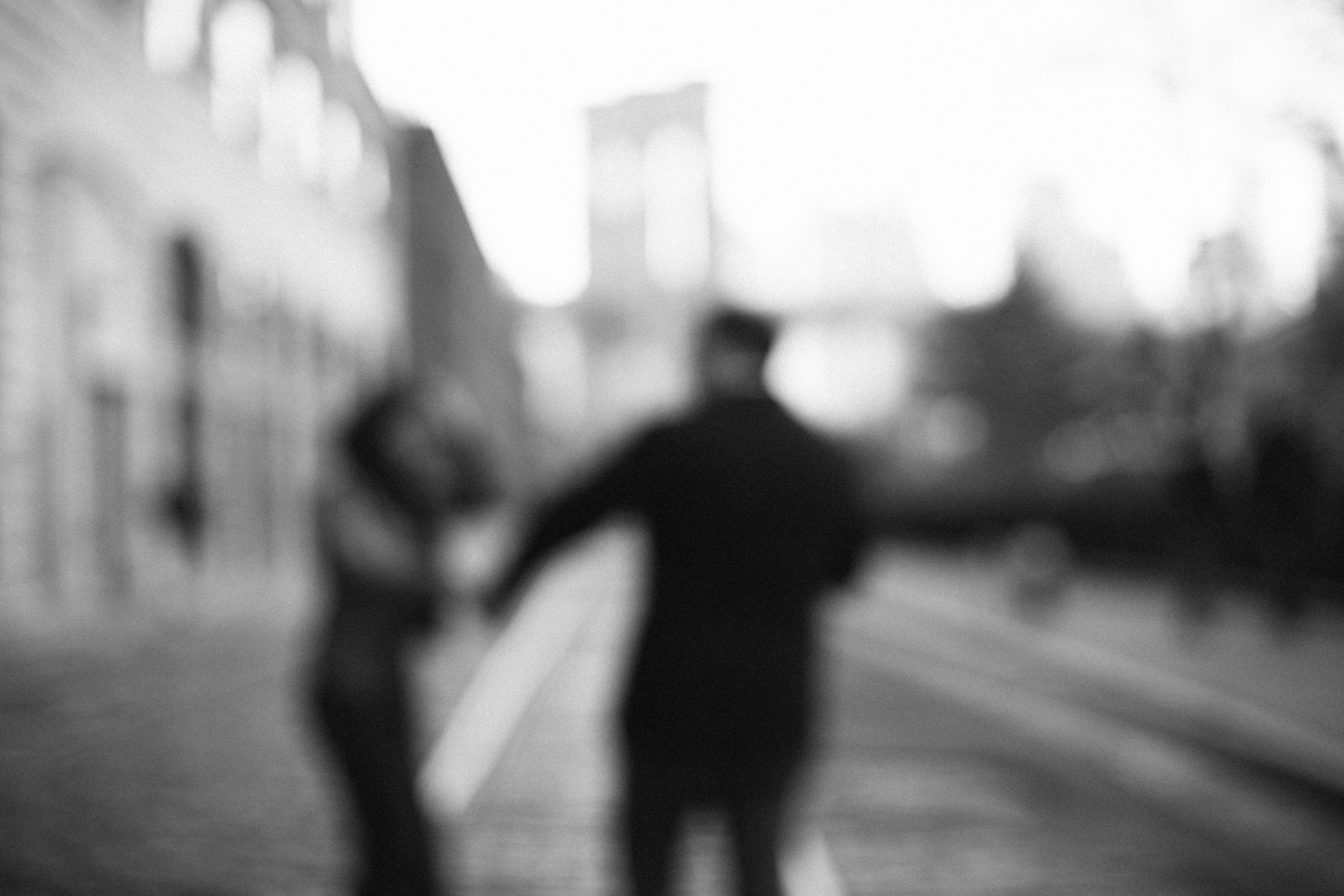 out of focus black and white laughing man and woman in dumbo
