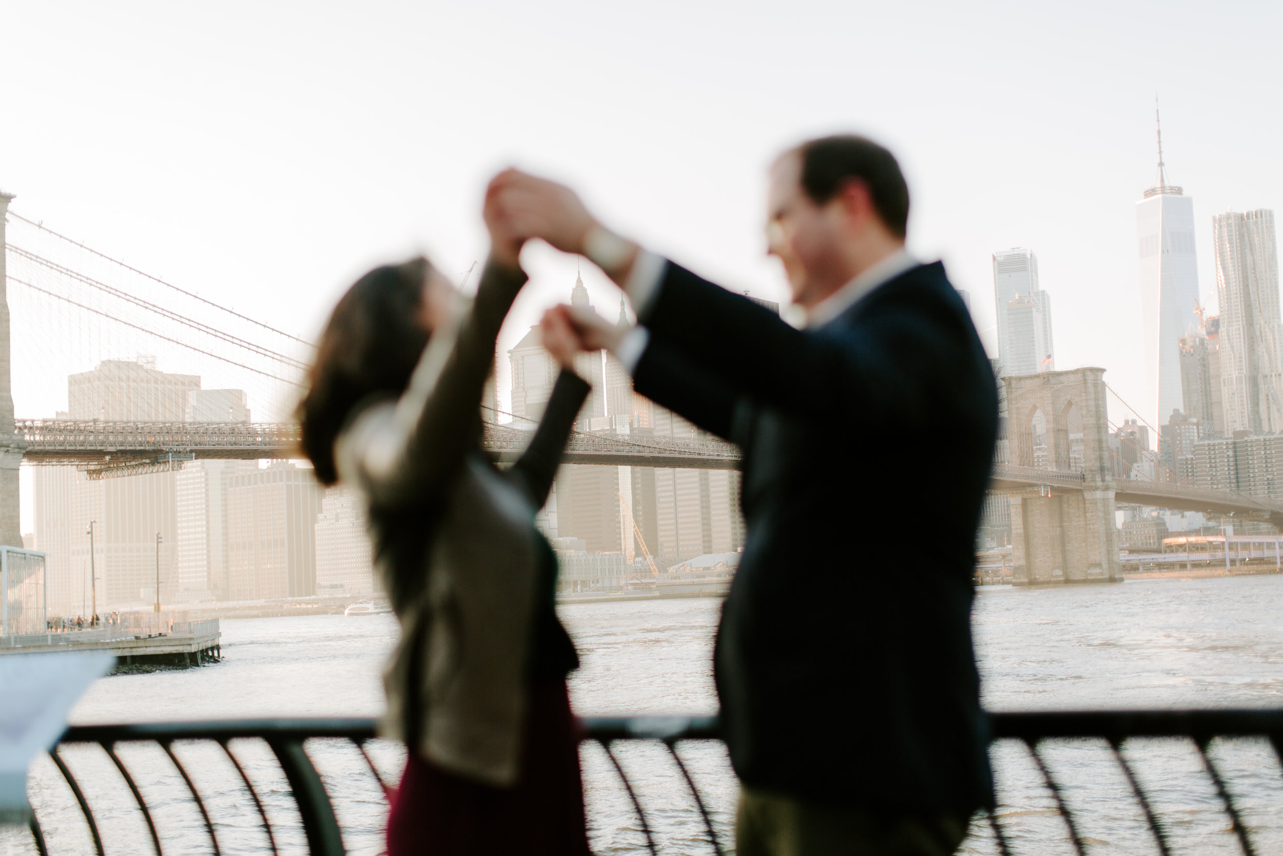 out of focus and holding hands in front of manhattan