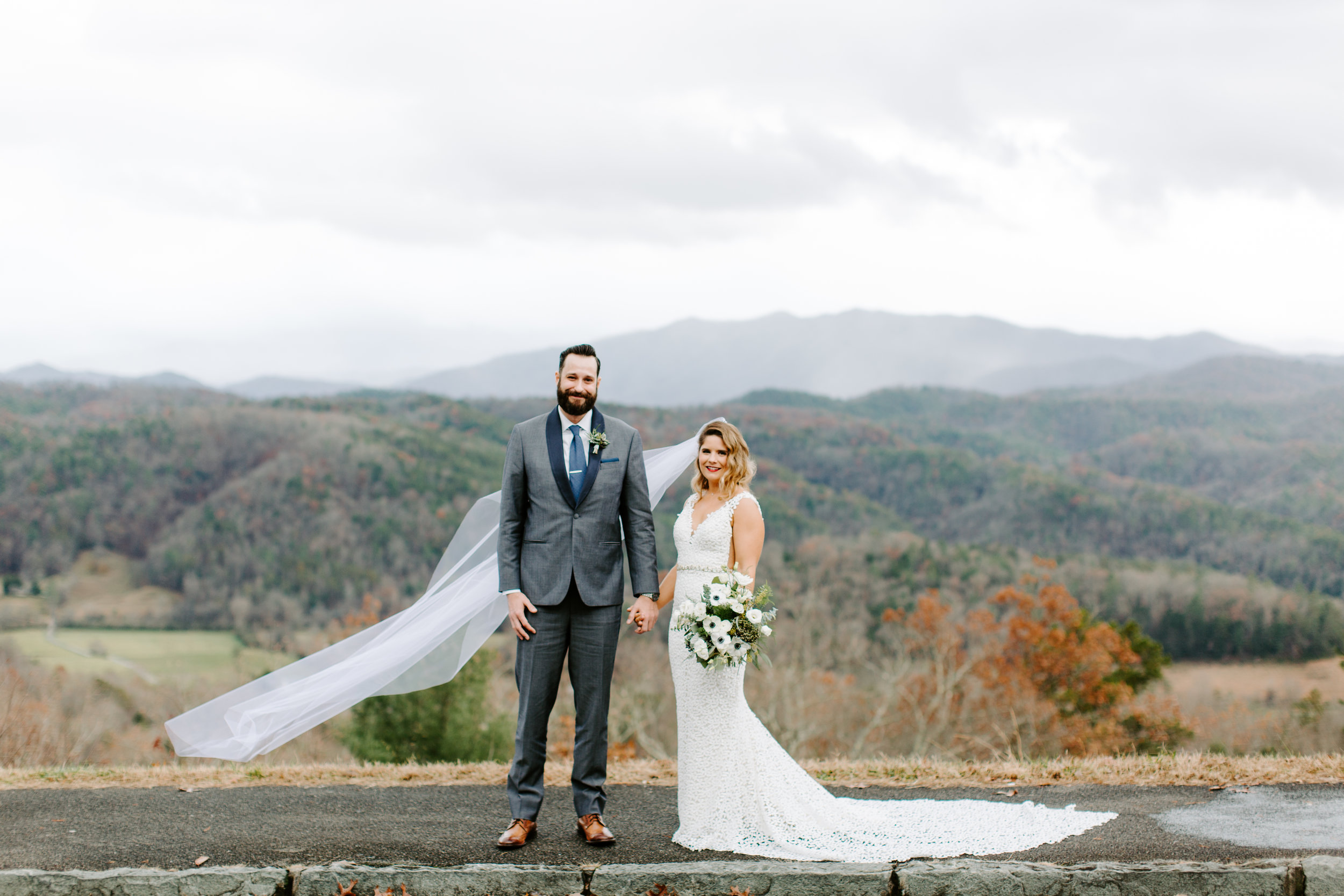bride and groom portraits with mountains in the background